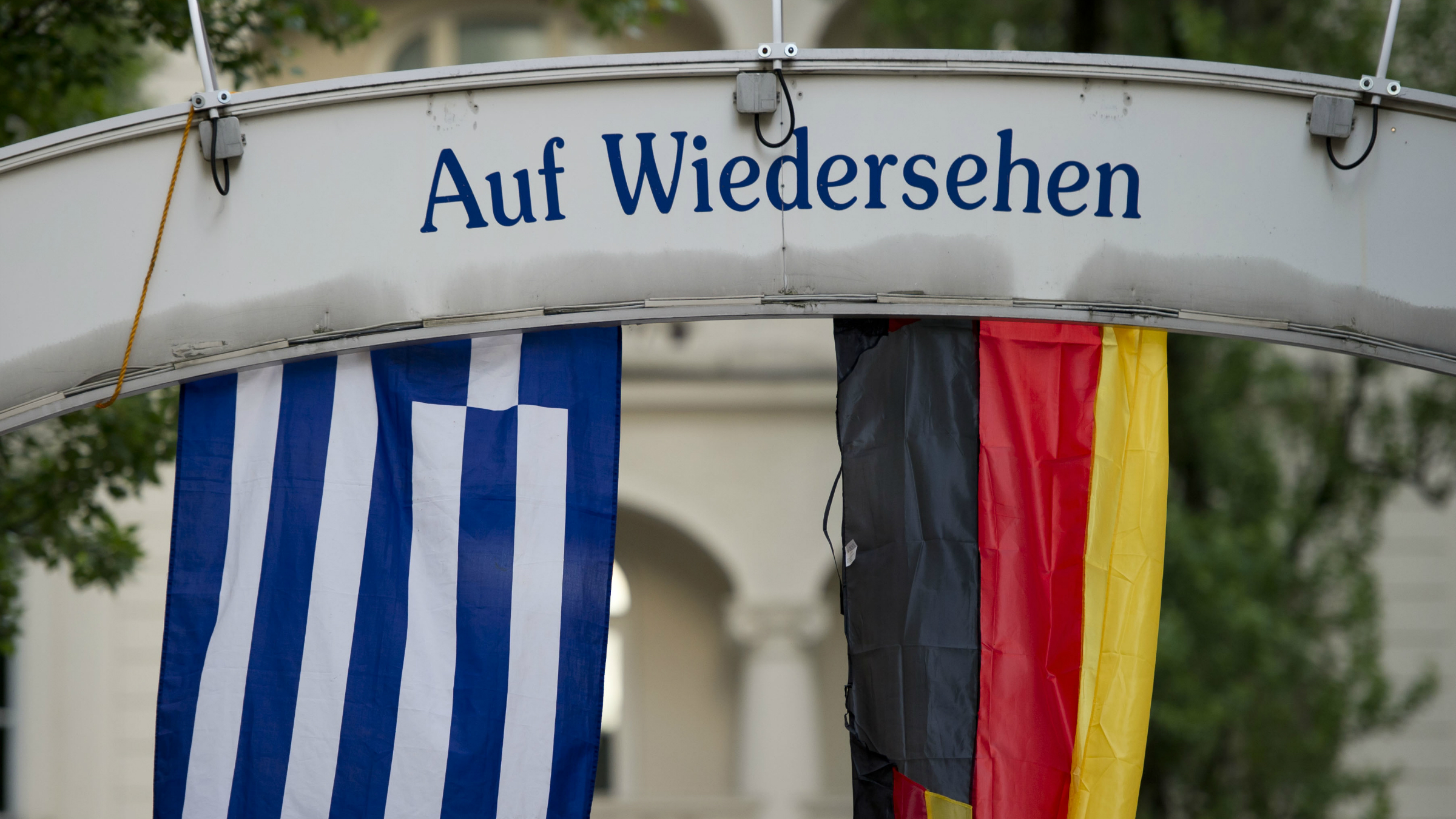Germany Greece flags and a goodbye sign