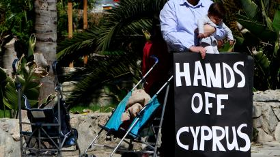 A child and protest banner in Cyprus