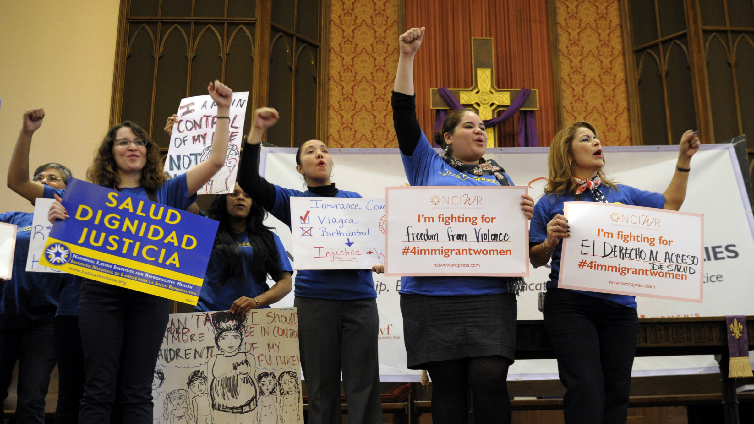 A coalition of women's groups participate in a rally supporting immigration reform on Monday, March 18, the day of Karen Panetta's Senate hearing.
