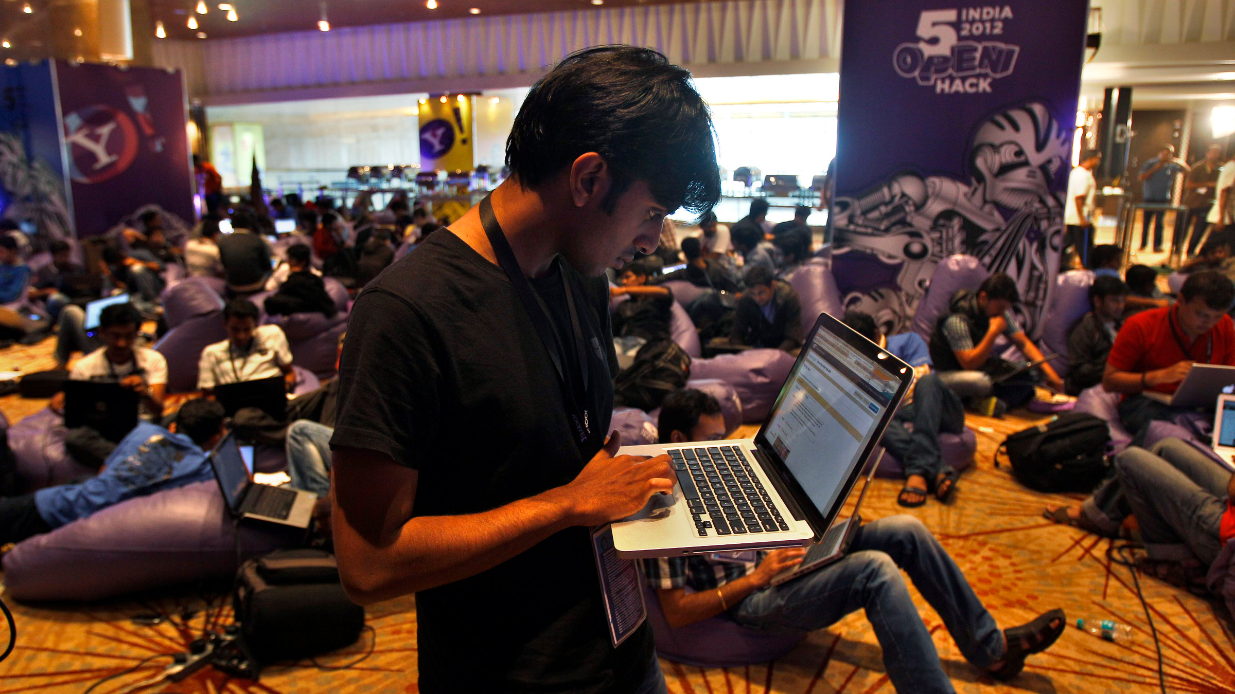 A participant works on his laptop during the fifth edition of Open Hack in India in Bangalore, India, Sunday, Aug. 12, 2012. About 700 software engineers and developers took part in the 24-hour open hacking competition organized by Yahoo, which gives developers a chance to work together and build applications and product ideas using different technologies to develop something that can potentially solve a real-world problem that impact internet users.