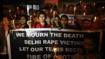 Indian girls mourning the 23-year-old gang rape victim.