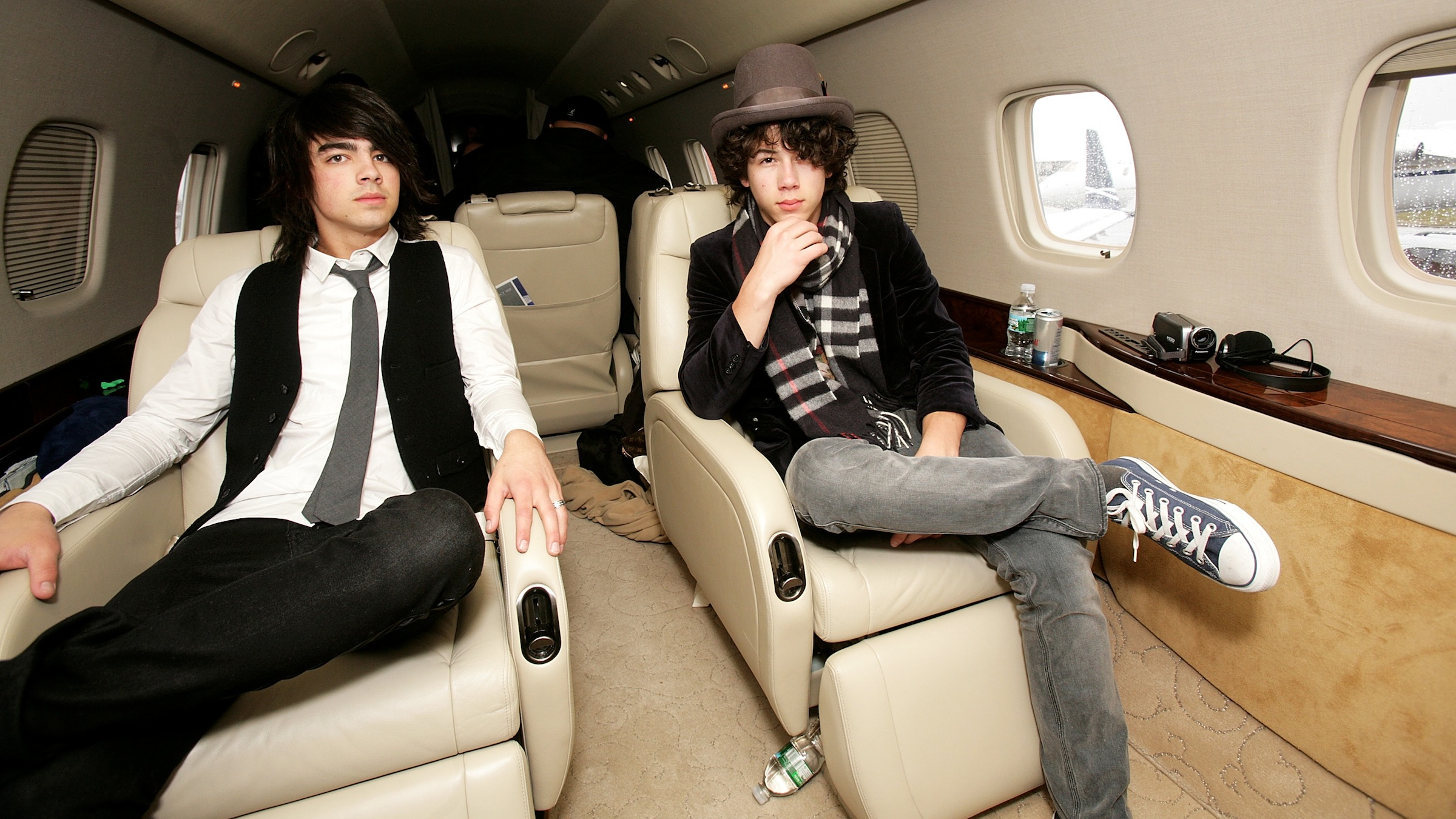 (UK TABLOID NEWSPAPERS OUT)  The Jonas Brothers, (L-R) Joe, Nick and Kevin, touch down in the UK onboard a private jet at Luton Airport on March 10, 2008 near London, England.