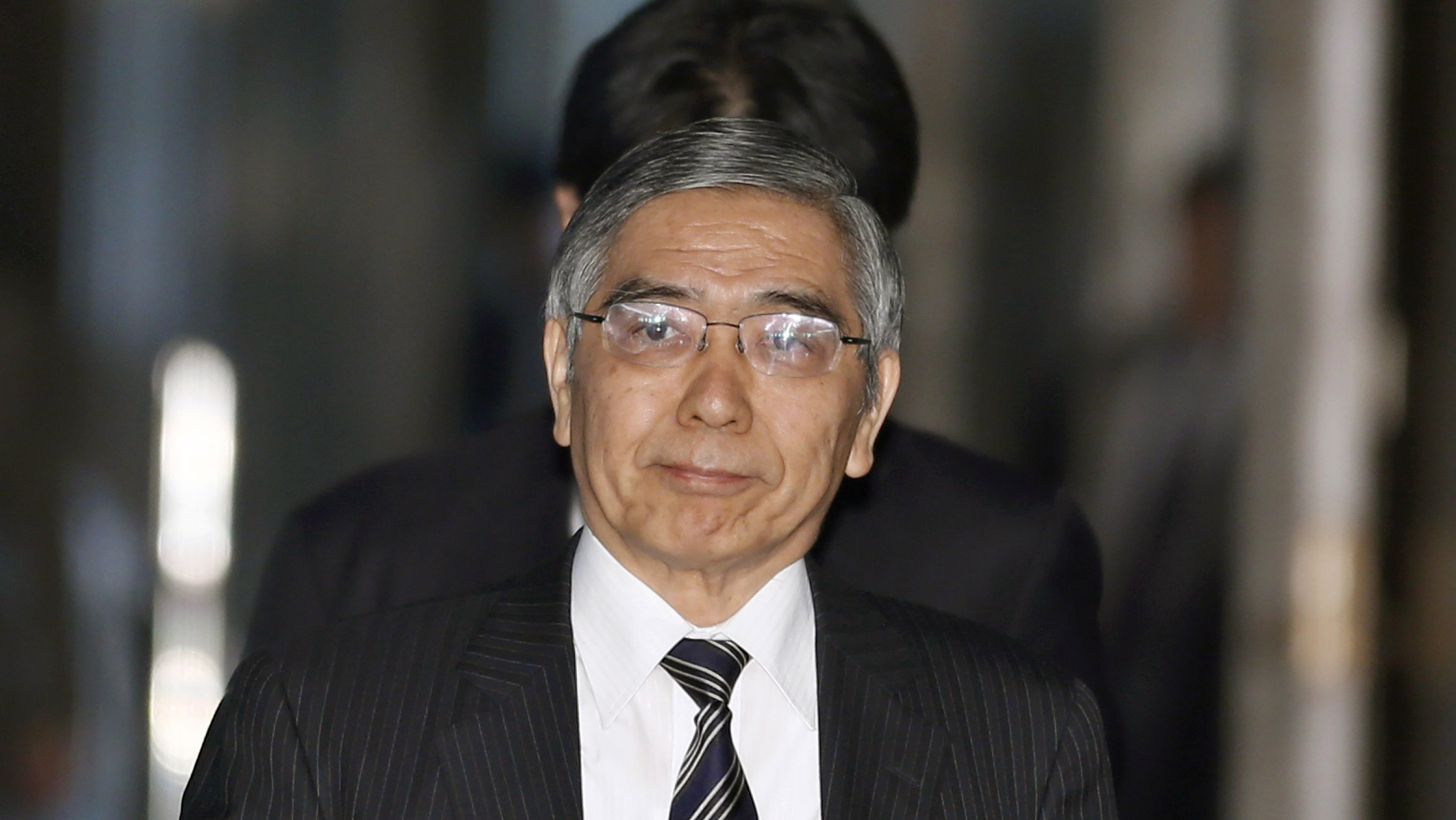 Asian Development Bank President Haruhiko Kuroda, who was recently nominated by Japan's Prime Minister Shinzo Abe to head the country's central bank, arrives at a lower house committee meeting in Tokyo, Monday, March 4, 2013. (AP Photo/Shizuo Kambayashi