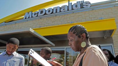 Rosaland Hemphill, 48, of Atlanta, fills out a job application at an Atlanta McDonald's restaurant Tuesday, April 19, 2011. McDonald's hopes to hire 50,000 new workers nationwide on April 19, 2011. (AP Photo/John Bazemore