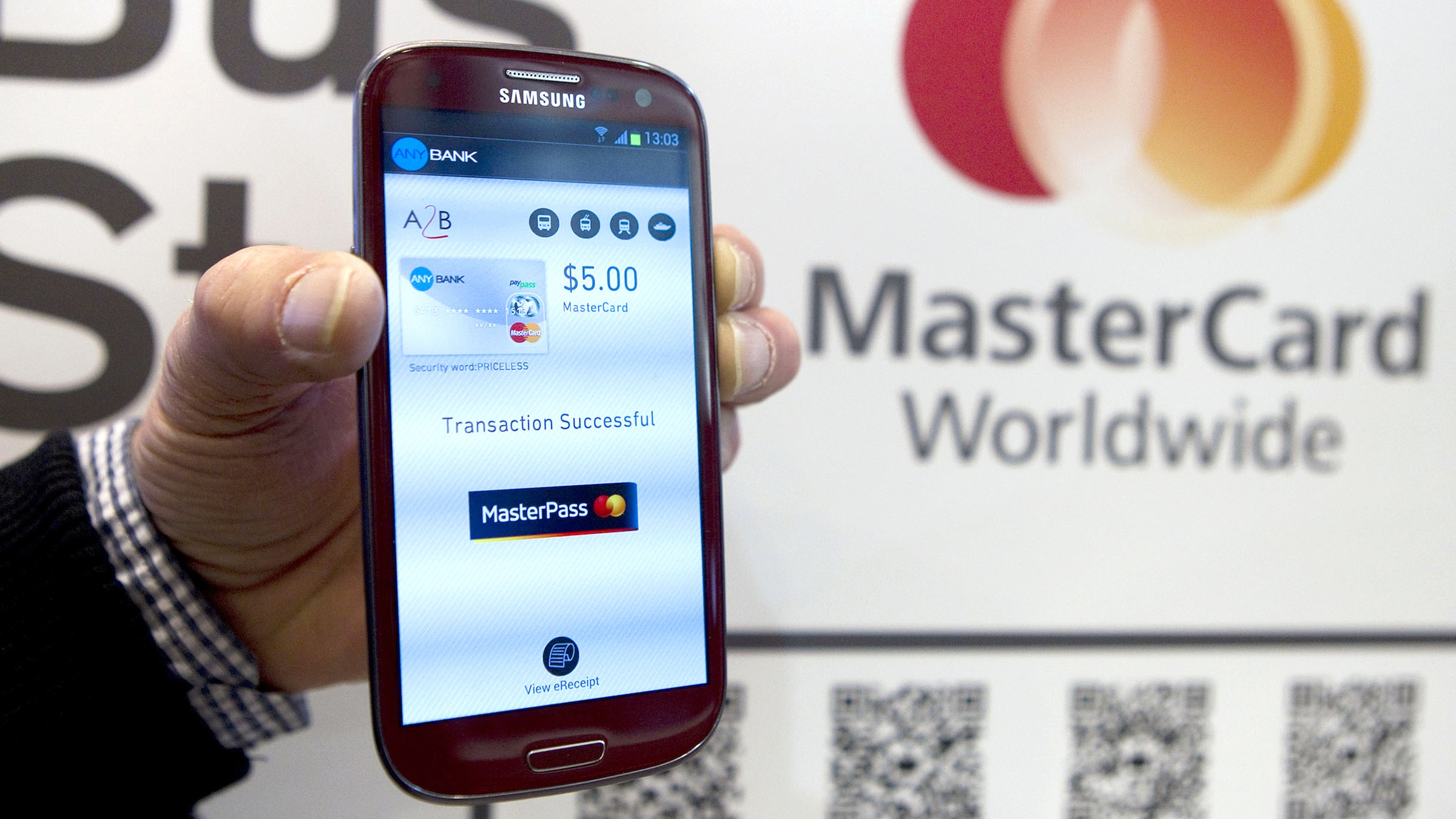 MasterCard showcases the future of payments with MasterPass at the Mobile World Congress . MasterPass is a new digital service that allows consumers to turn any device into a shopping device. Tuesday, Feb. 26, 2013 in Barcelona. (Marcel-li Saenz Martinez/AP Images for MasterCard)