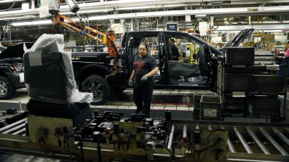 In this Thursday, Jan. 10, 2013 file photo, a Nissan employee reaches for a seat module to insert into a Titan truck at its Canton, Miss., manufacturing plant. The Federal Reserve reports on production from factories, mines and utilities in January on Friday, Feb. 15, 2013. (AP Photo/Rogelio V. Solis