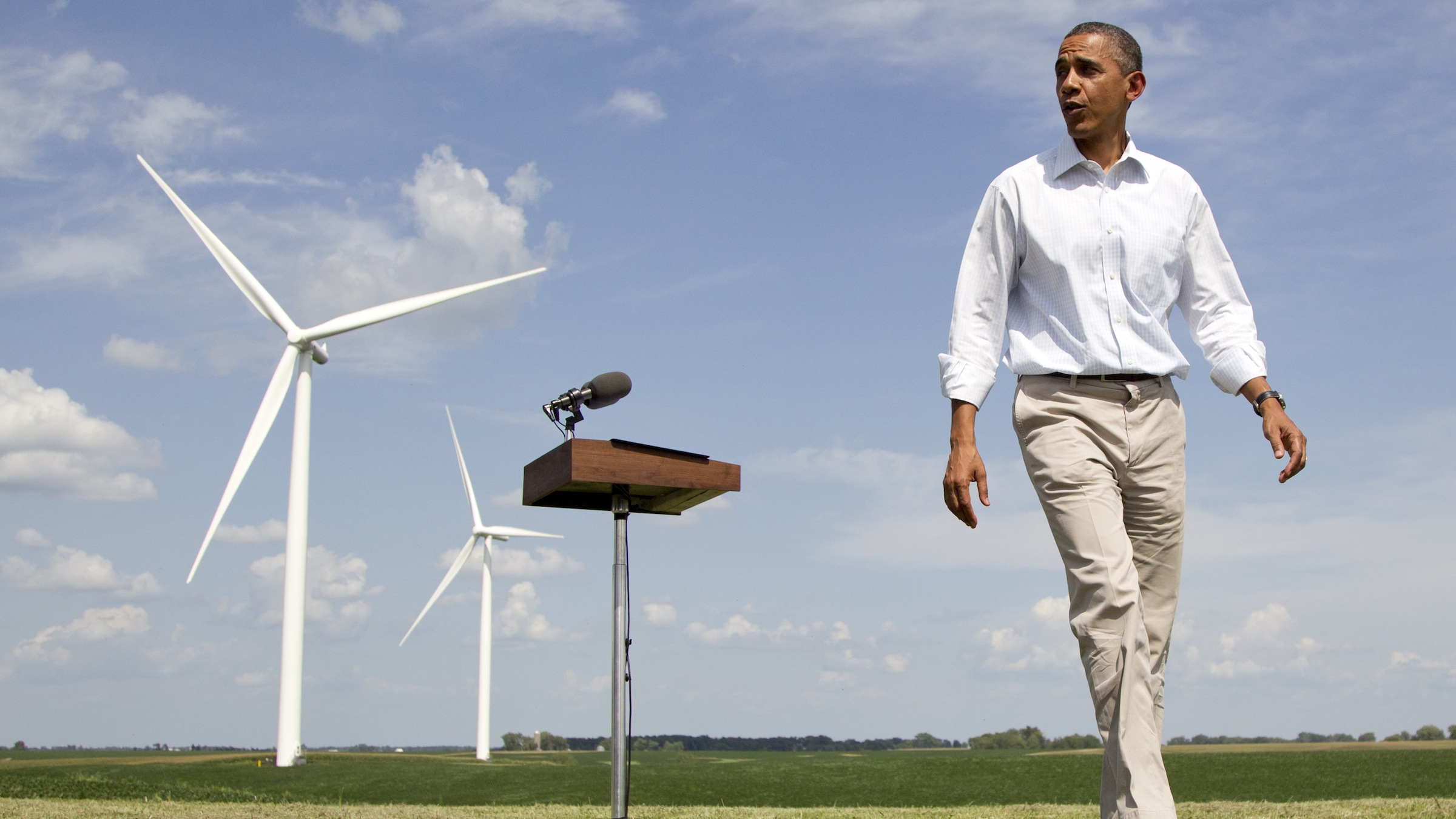 Barack Obama with wind turbines in the background