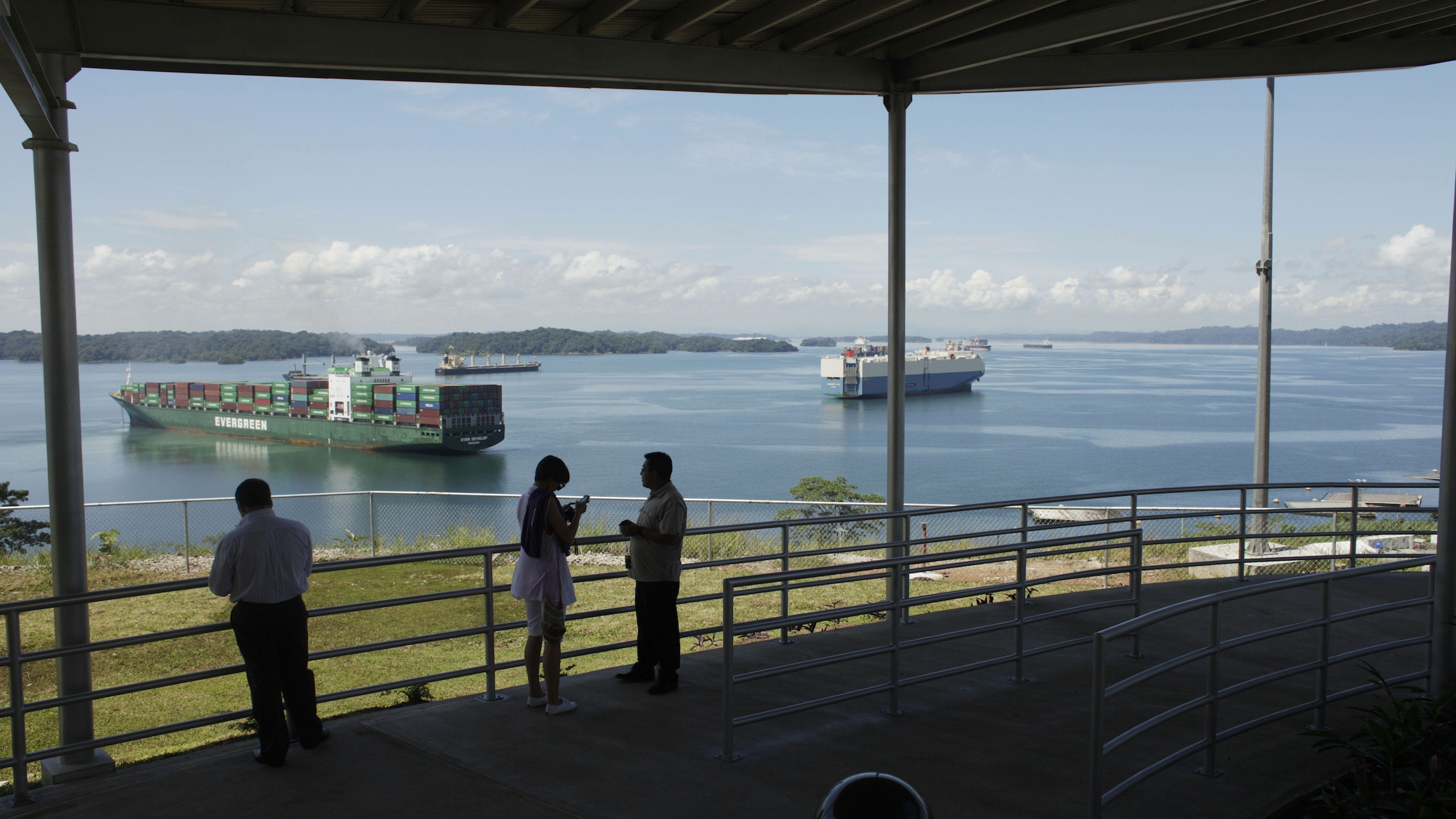People stand in a new viewing area of the Panama Canal during a media tour in Gatun, Panama, Wednesday, Aug. 15, 2012. The canal marks it's 98th anniversary on Wednesday as it undergoes the biggest expansion project since it opened in 1914, which will allow larger Post-Panamax ships to cross the canal. The new viewing location is currently open to canal workers but will open to tourists when the canal expansion project is done, planned for in 2014. (AP Photo/Arnulfo Franco)