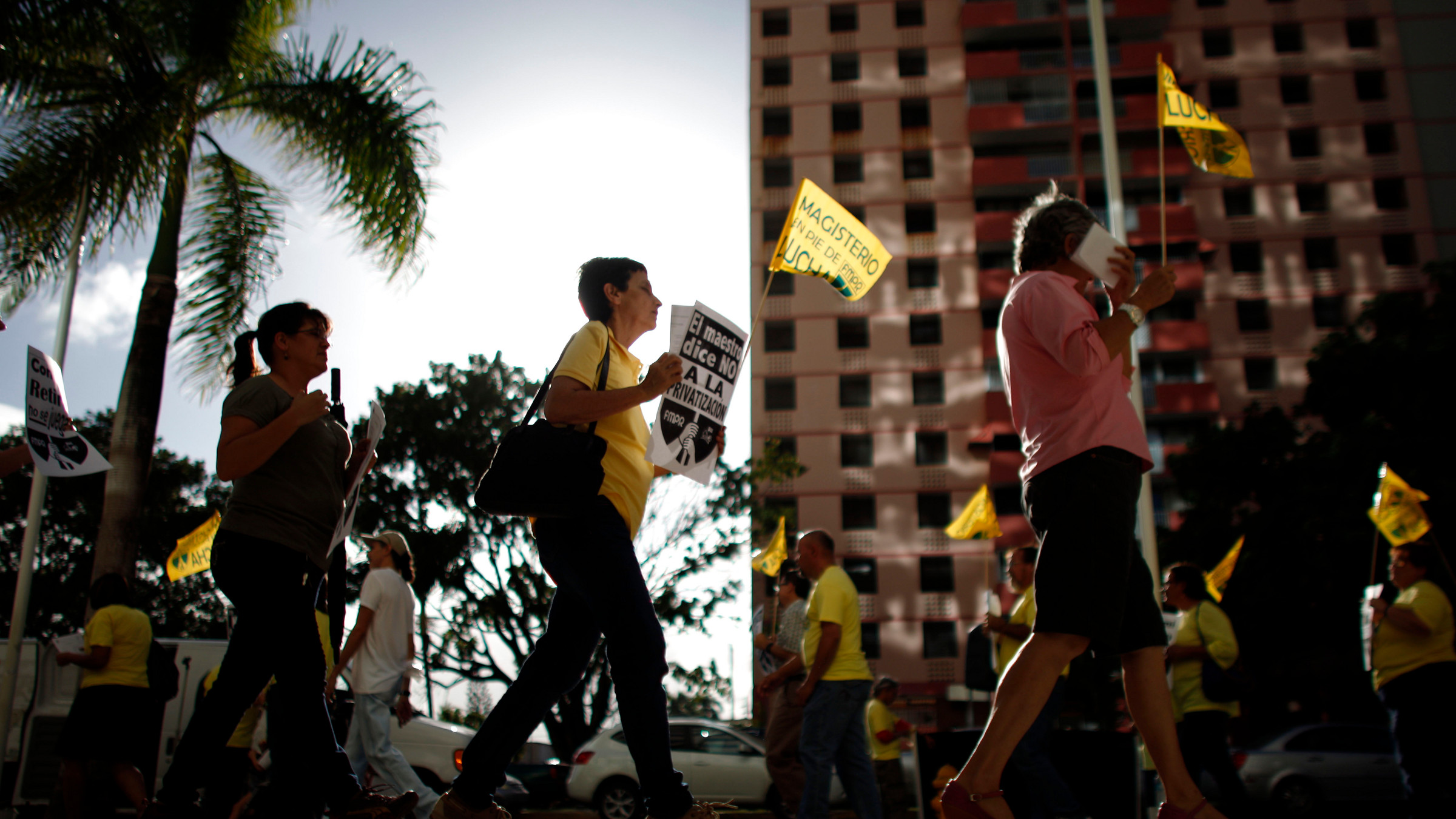 People protest outside the government pension headquarters in San Juan, Puerto Rico, Wednesday, Jan. 30, 2013.