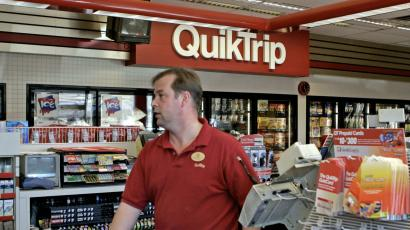 Patrick Field, an employee at the Quick Trip store in Florissant, Mo., waits on customers Thursday, April 13, 2006. The biggest Powerball jackpot in Missouri history, $224.2 million, remains unclaimed after the winning ticket was sold at the Florissant QuikTrip convenience store.