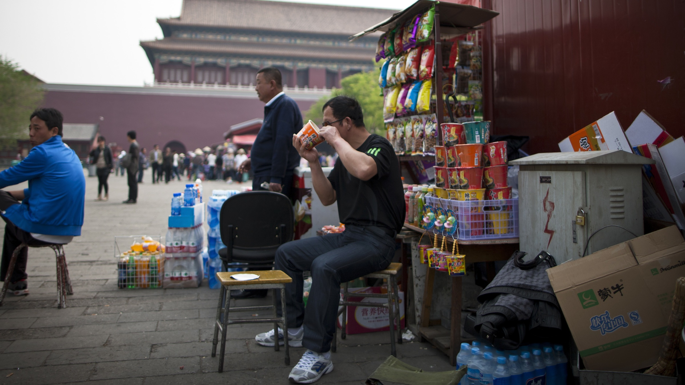 A Chinese man eats instant noodle at a store set up inside Forbidden City in Beijing, China Thursday, April 28, 2011. (AP Photo/Andy Wong)
