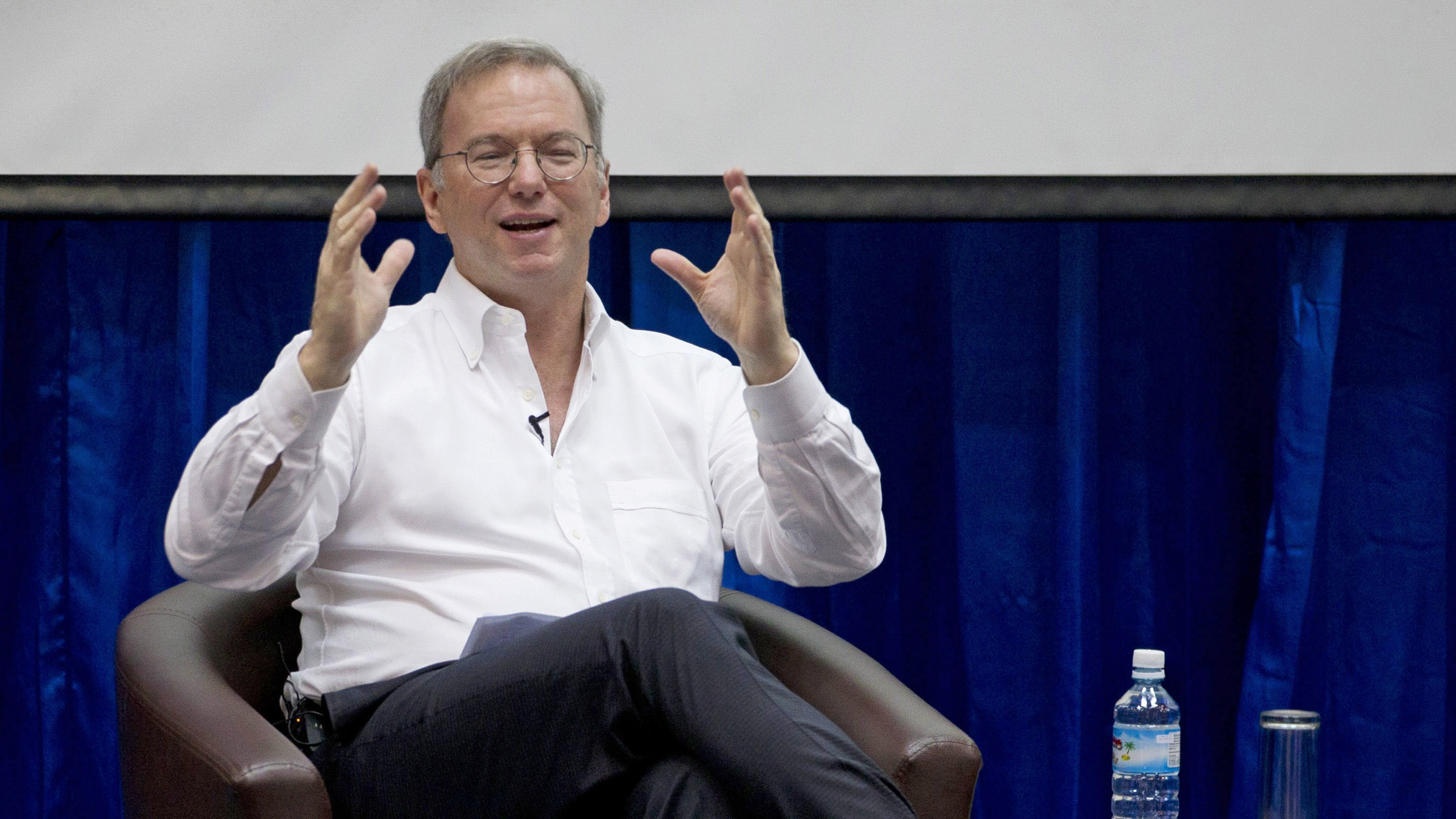 "Google executive chairman Eric Schmidt gestures during  an interactive session with group of students at a technical university in Yangon, Myanmar, Friday, Mar 22, 2013. Schmidt on Friday urged Myanmar's government to allow the private sector to develop the country's woeful telecommunications infrastructure, emphasizing the importance of competition and free speech. Schmidt's visit to Myanmar comes after trips to Libya, Afghanistan, and North Korea, which he said was a ""truly wacky place."" (AP Photo/Gemunu Amarasinghe)"