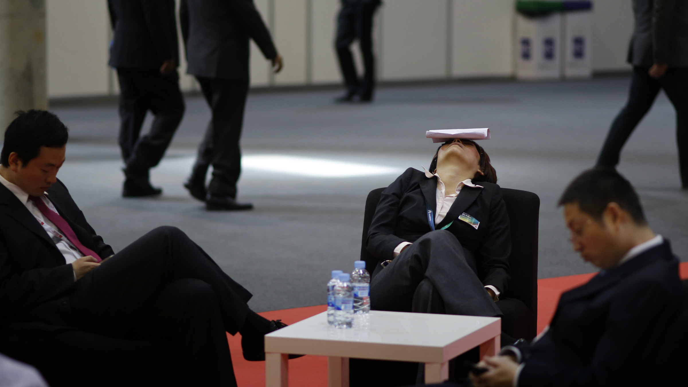 A conference member taking a nap