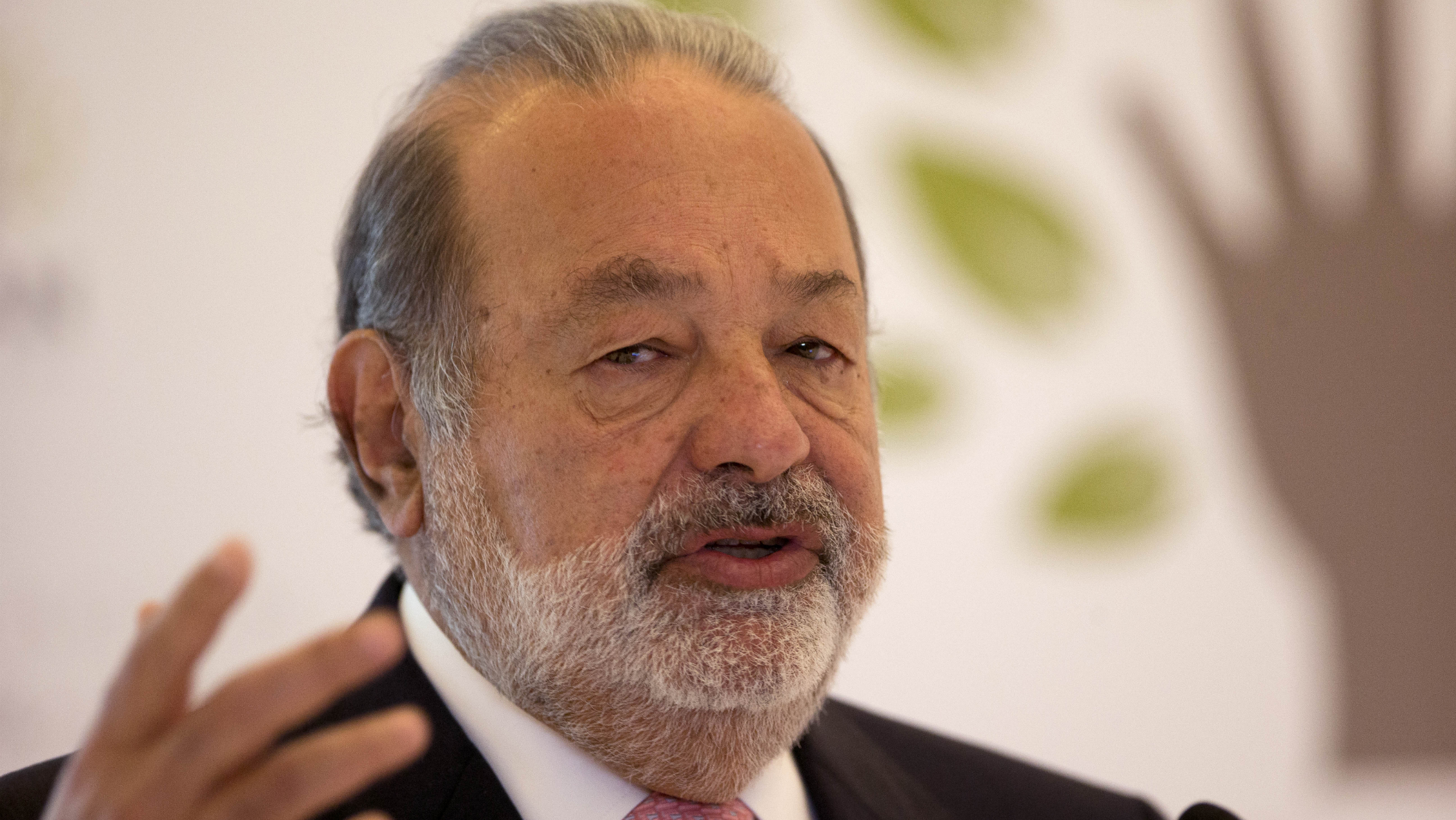 Mexican telecommunications tycoon Carlos Slim speaks during news conference at the Soumaya museum in Mexico City,Monday, Jan. 14, 2013. Slim announced an educational partnership between his Carlos Slim Foundation with the Khan Academy. (AP Photo/Dario Lopez-Mills