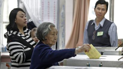 An elderly voter casts her ballot at a polling station in Taipei, Taiwan, Saturday, Jan. 14, 2012. Taiwanese voted Saturday in a closely fought presidential election that pits incumbent Ma Ying-jeou's vision of better relations with China against his main challenger's attempts to galvanize resentment over growing income inequality. (AP Photo/Vincent Yu)