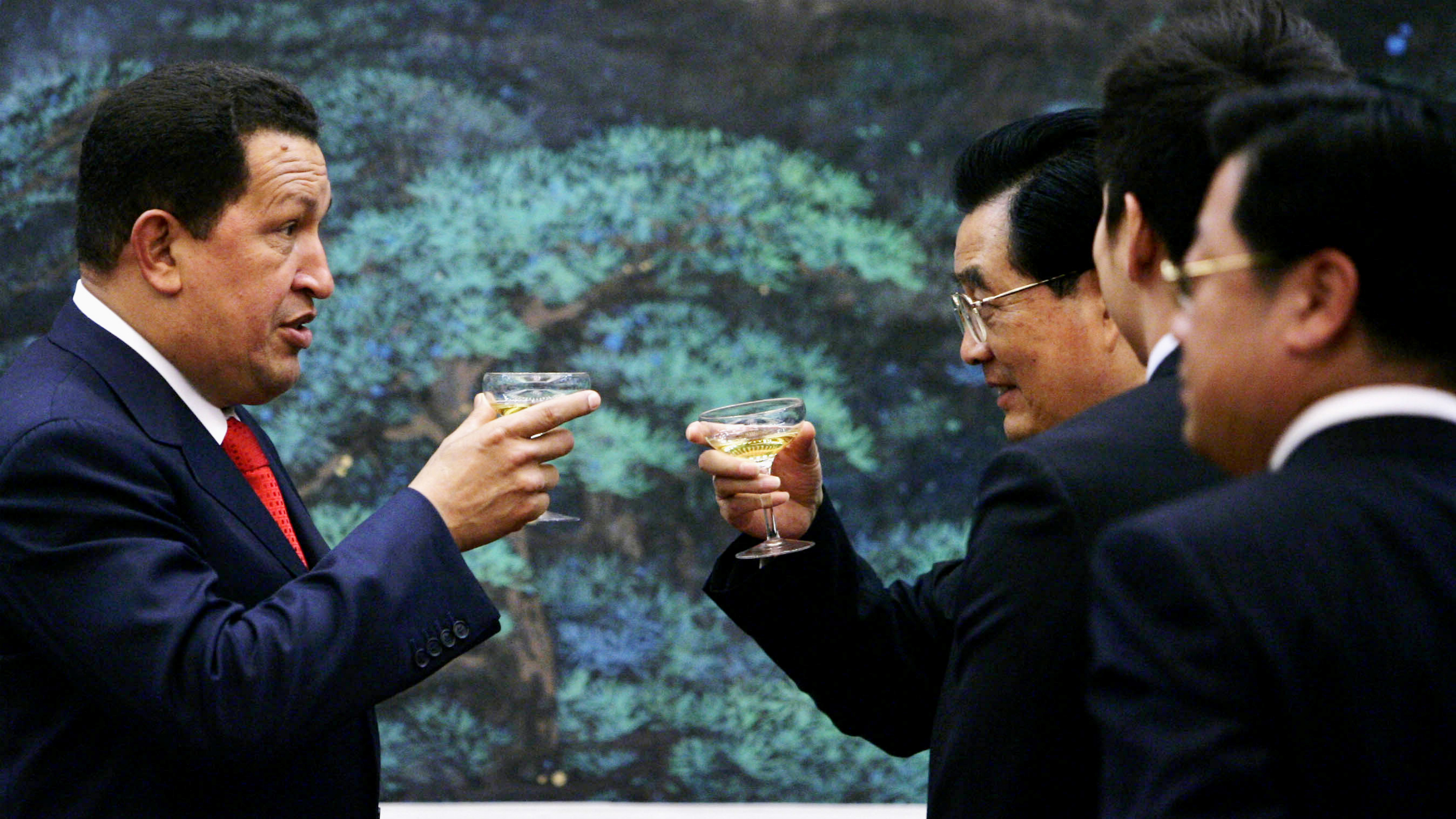 Chinese President Hu Jintao, right, and Venezuelan President Hugo Chavez toast after a ceremony to sign agreements between the two nations at the Great Hall of the People in Beijing Wednesday, Sept. 24, 2008. Chavez said his country's oil exports to China could soar to 1 million barrels a day by 2012. Chavez's visit this week to Beijing has focused on trade and business ties, including refinery construction deals and China's launch of a Venezuelan communications satellite. (AP Photo/ Elizabeth Dalziel