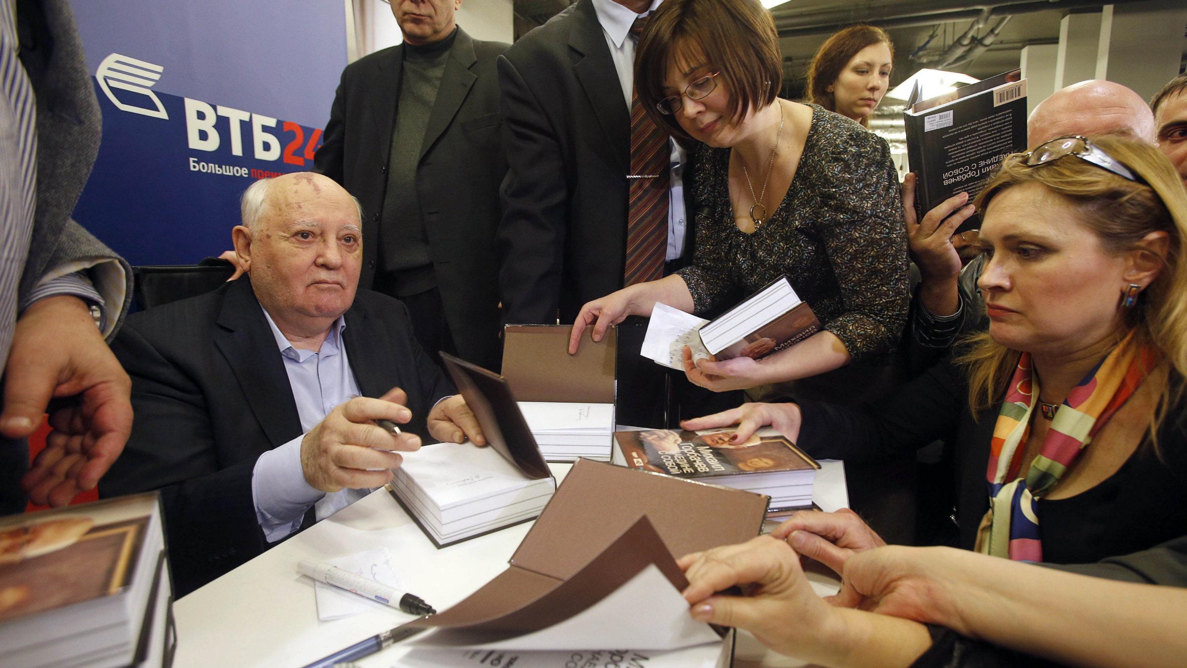 Mikhail Gorbachev signing books