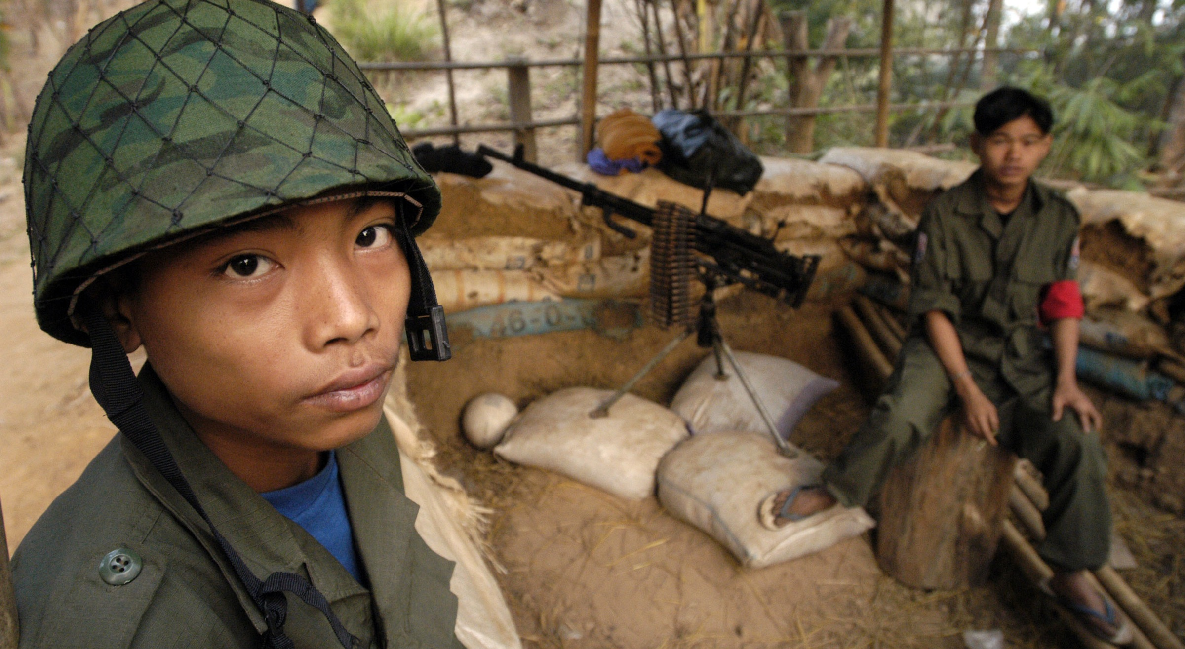 ** TO GO WITH STORY SLUGGED: MYANMAR CHILD SOLDIERS BY GRANT PECK ** Two young ethnic Karen boys man a guard post at New Manerplaw, Myanmar, Karen rebel territory Jan. 31, 2004. Myanmar's military government, already under criticism for abuses, is recruiting children as young as 10 into its armed forces, a U.S. rights group charged in a report released Wednesday, Oct. 31, 2007.  (AP PHoto/David Longstreath).