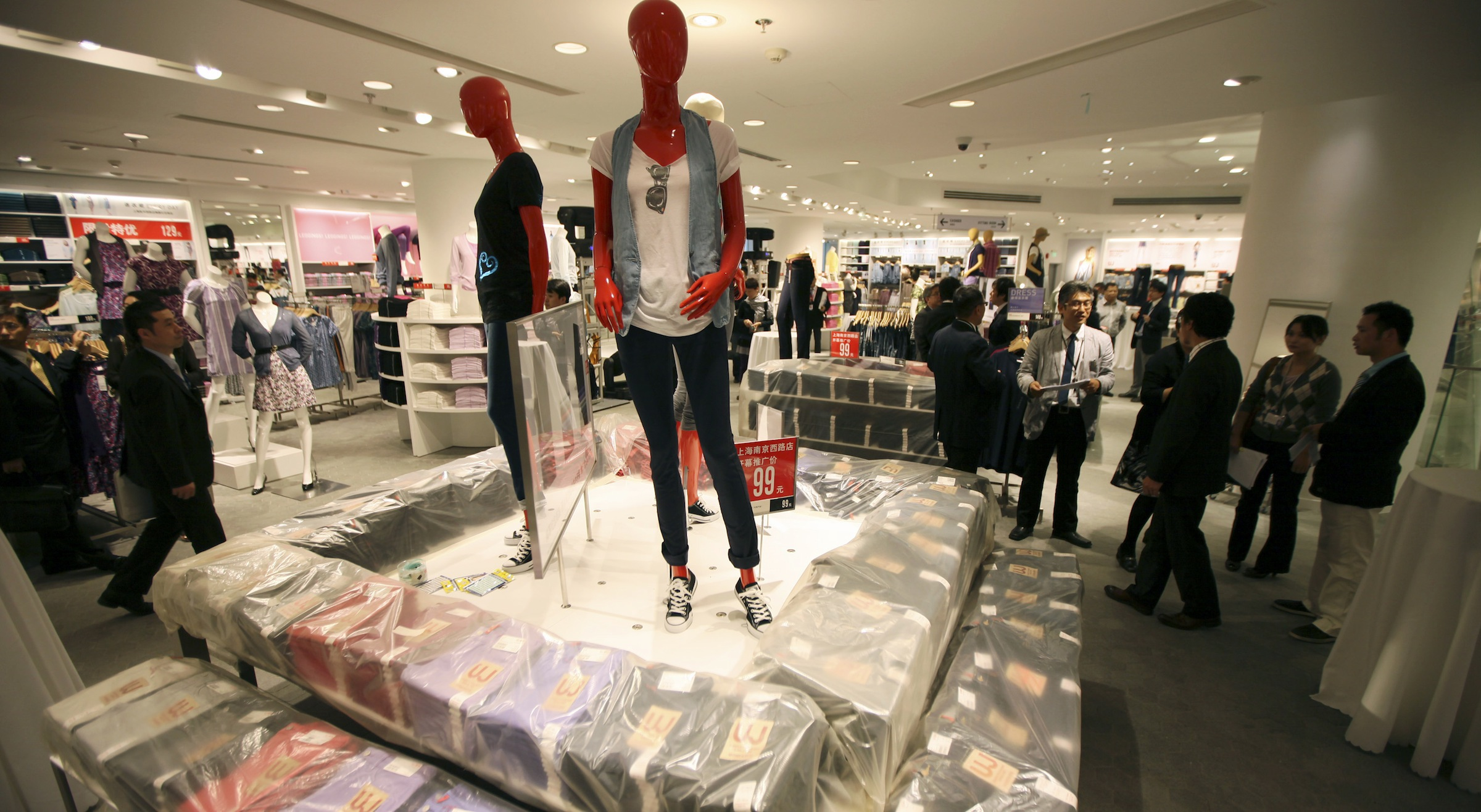 Guests look around interior of the largest global flagship store of Uniqlo Thursday, May 13, 2010 in Shanghai, China. The UNIQLO Shanghai Global Flagship Store will open on May 15 officially. (AP Photo/Eugene Hoshiko)
