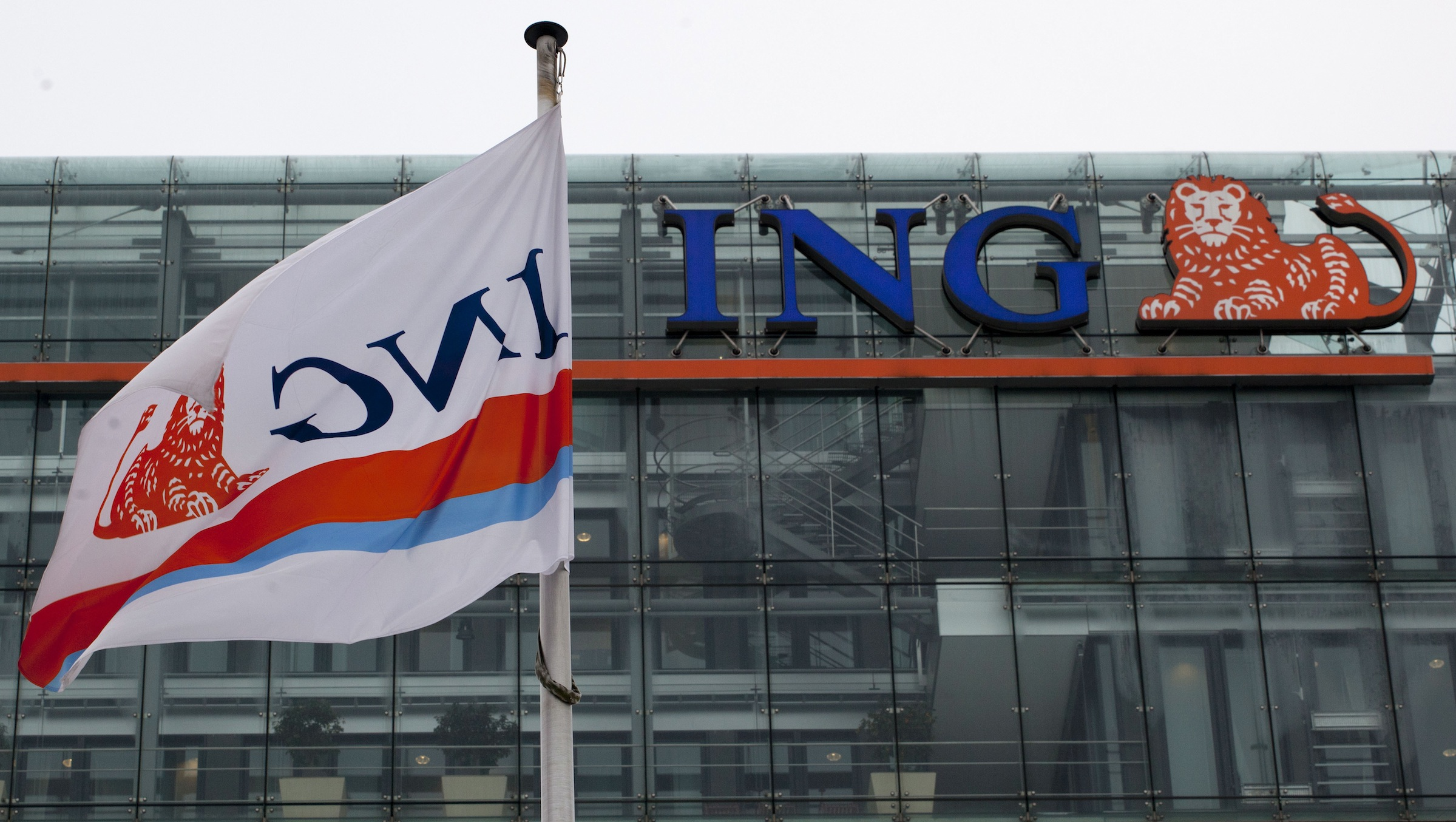 A branded flag flies outside the ING head office in Amsterdam, Thursday, Feb. 9, 2012. One-off gains from the sale of businesses helped Dutch bank and insurance group ING Groep NV post a significant profit advance in the fourth quarter of last year even though Europe's debt crisis increasingly weighed on business. (AP Photo/Peter Dejong)