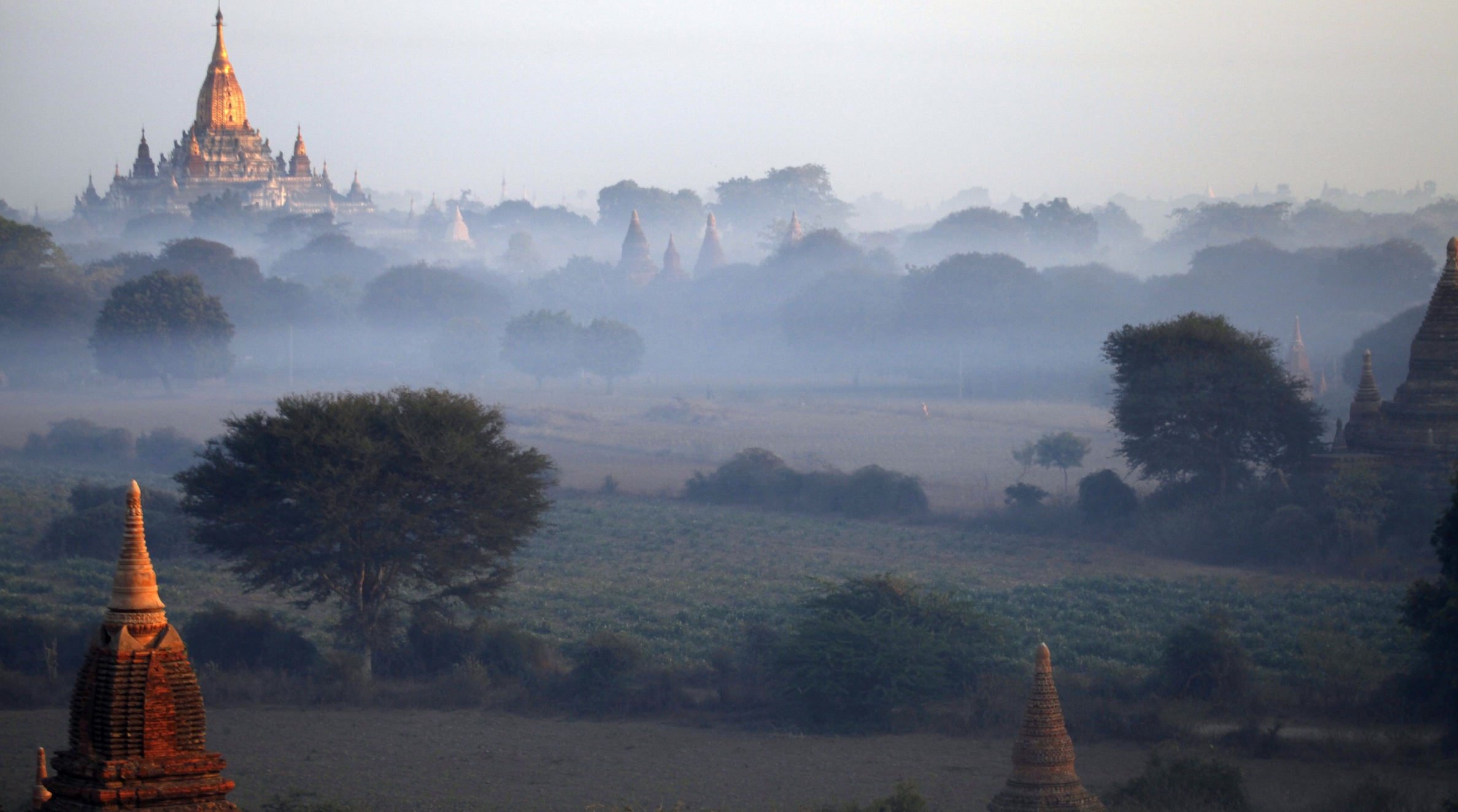 Ancient temples stand during the sun rise in Bagan, central Myanmar, Friday, Jan.25, 2013. (AP Photo/Khin Maung Win
