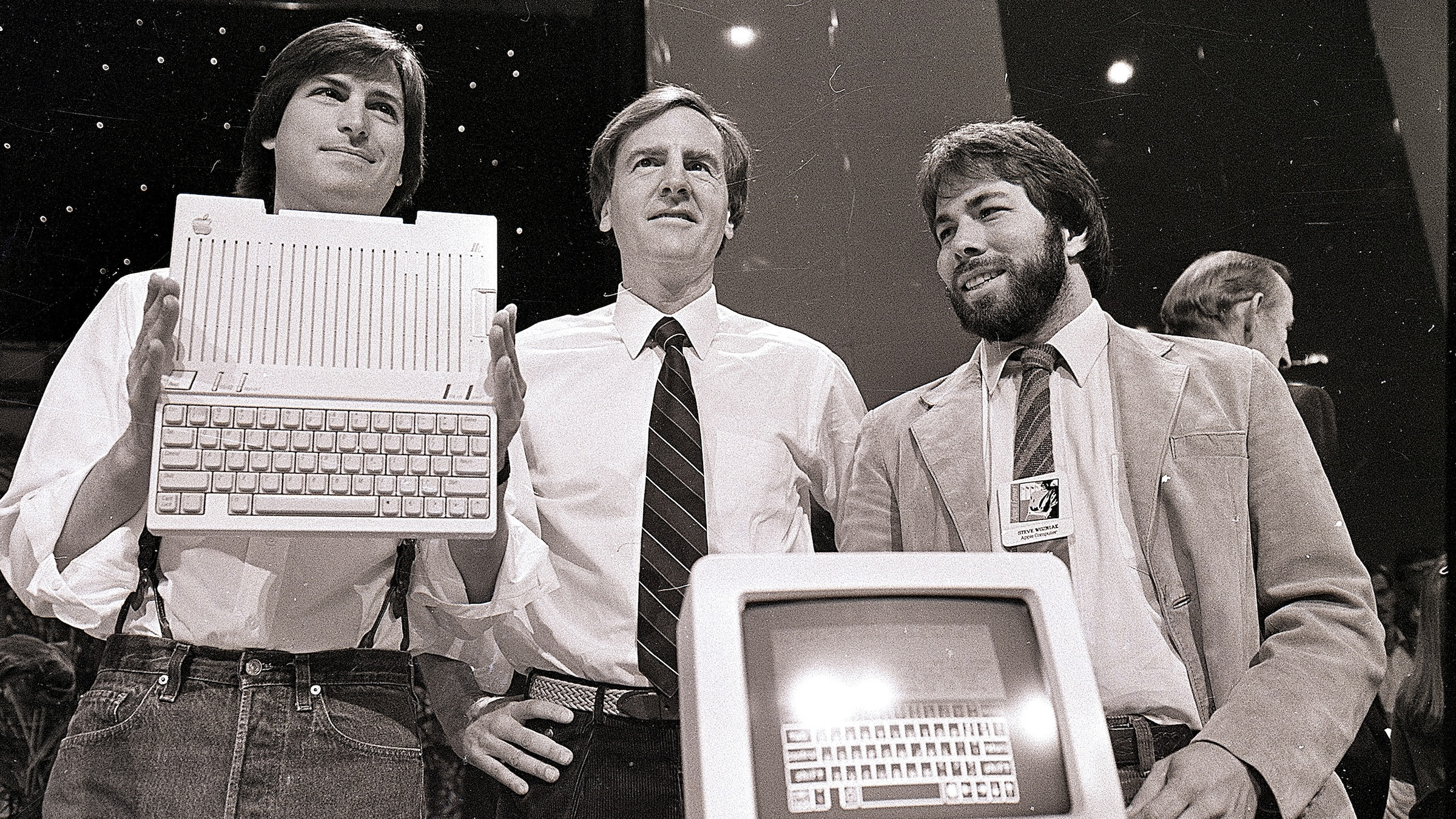 FILE - In this April 24, 1984 file photo, Steve Jobs, left, chairman of Apple Computers, John Sculley, center, then president and CEO, and Steve Wozniak, co-founder of Apple, unveil the new Apple IIc computer in San Francisco. Apple Inc. on Wednesday, Aug. 24, 2011 said Jobs is resigning as CEO, effective immediately. He will be replaced by Tim Cook, who was the company's chief operating officer. It said Jobs has been elected as Apple's chairman.  (AP Photo/Sal Veder, File)