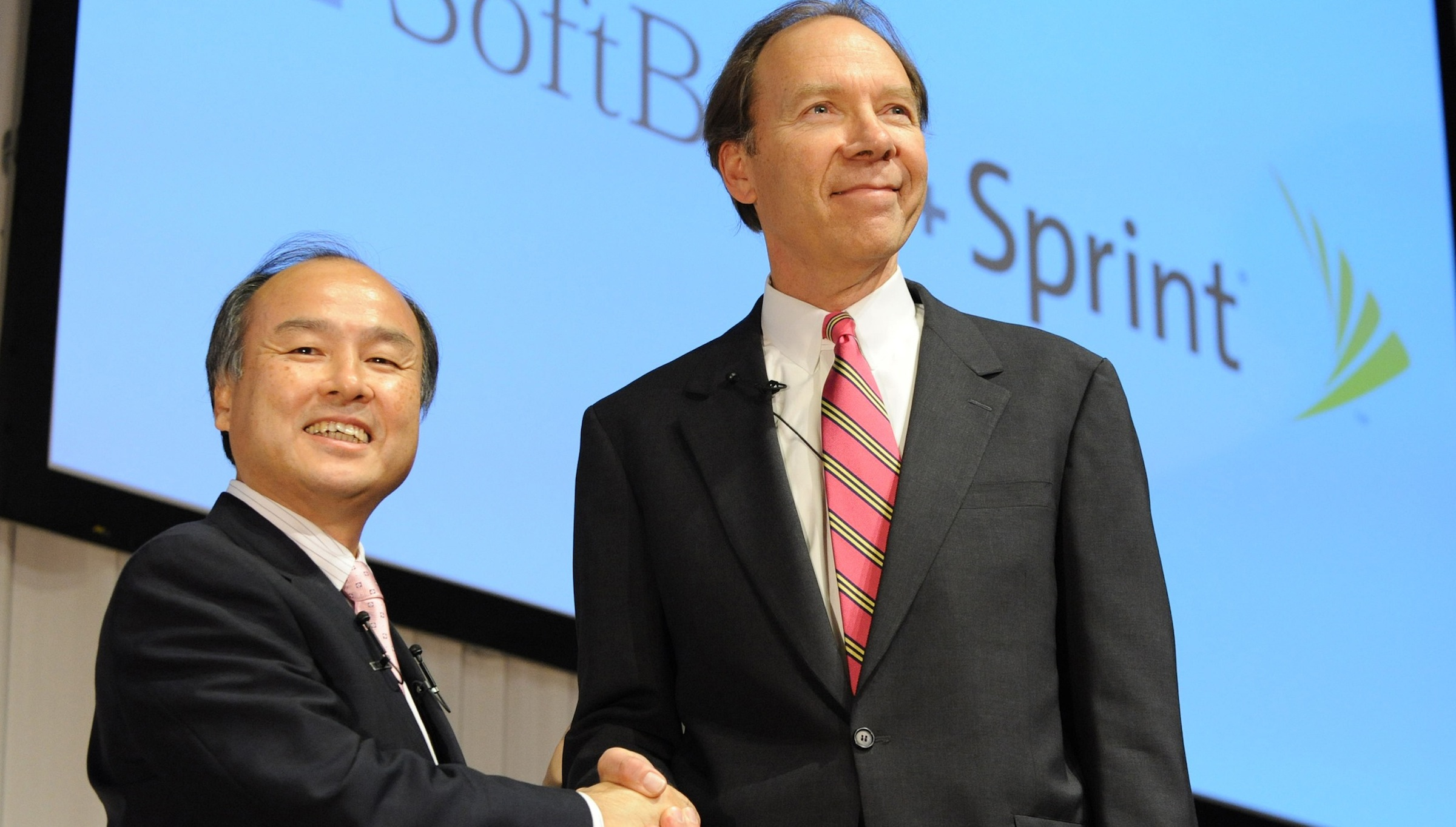 FILE -In this Oct. 15, 2012, file photo, Son Masayoshi, left,  president of Softbank Corp. shakes hands with Dan Hesse, CEO of Sprind Nextel Corp. during a joint news conference in Tokyo. Subscriber trends are turning south again for Sprint Nextel as it struggles to compete with Verizon Wireless, the industry leader.  The country's No. 3 wireless carrier says Thursday, Oct. 25, 2012, it lost overall subscribers for the first time in two and a half years in the third quarter, as customers gave up on the moribund Nextel network and the company failed to sign up enough of them on the Sprint network.   (The Yomiuri Shimbun via AP Images )