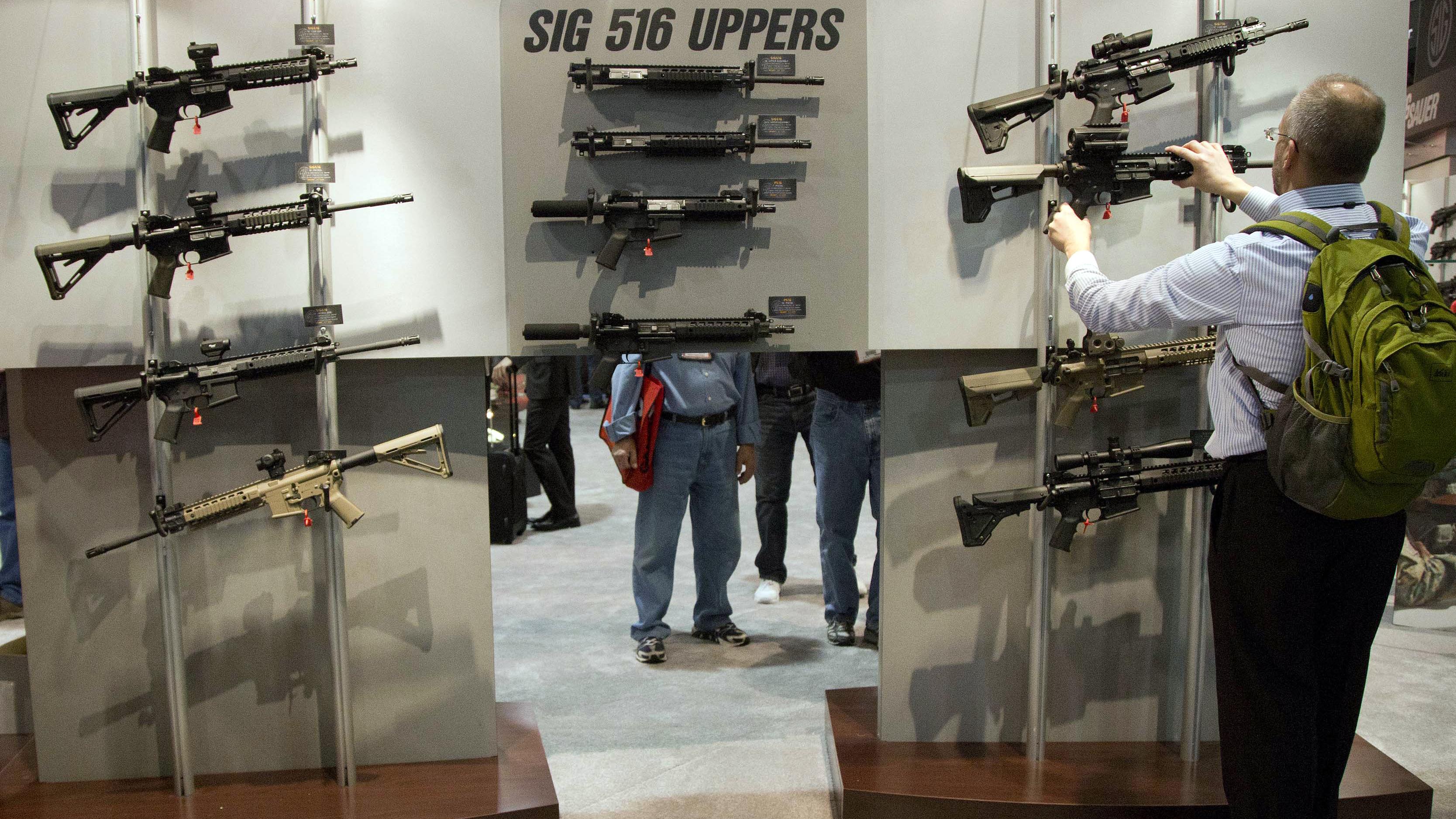 Assault rifles at a gun show