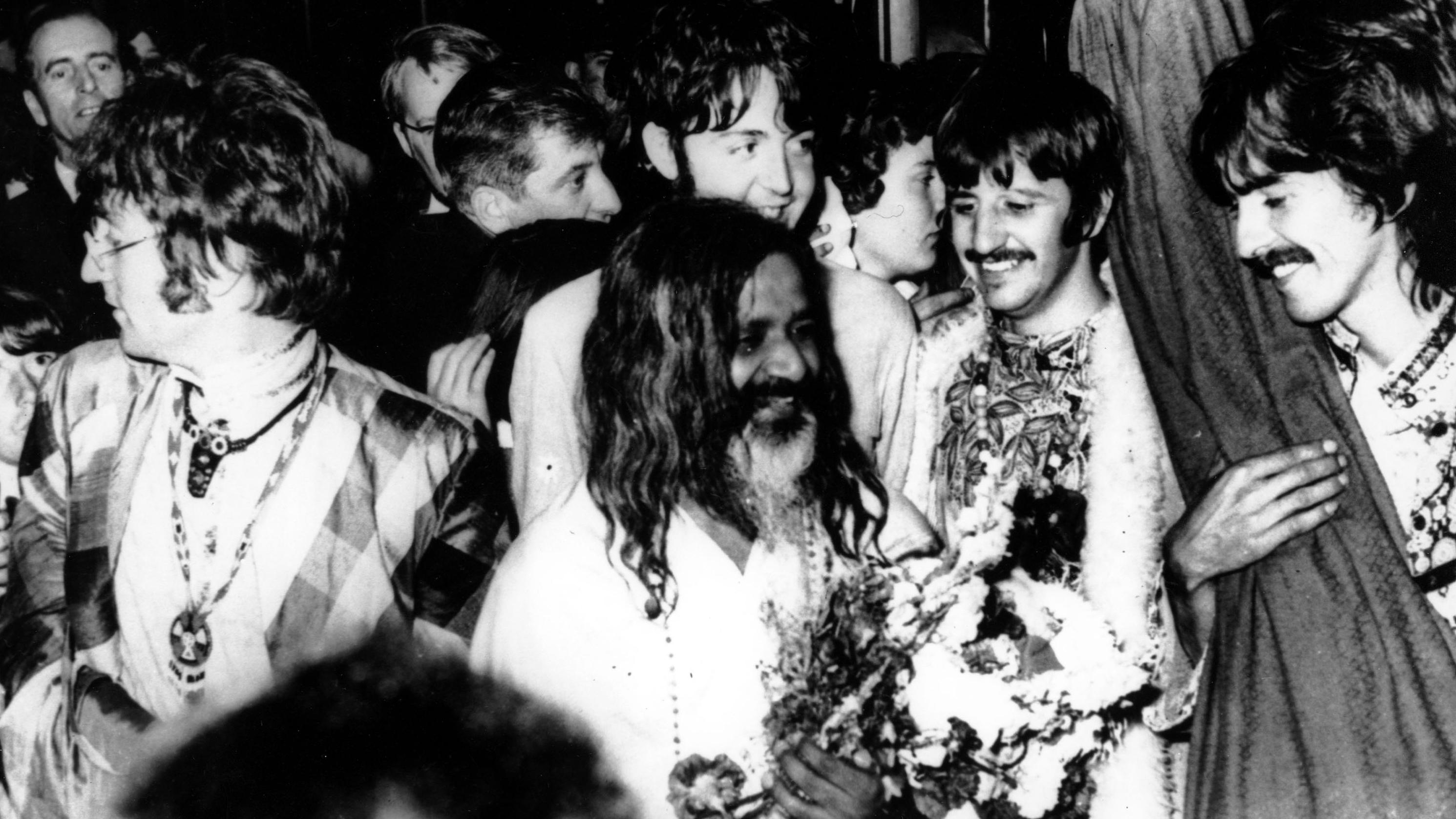 The Beatles with Maharishi Mahesh Yogi, the founder of transcendental meditation.