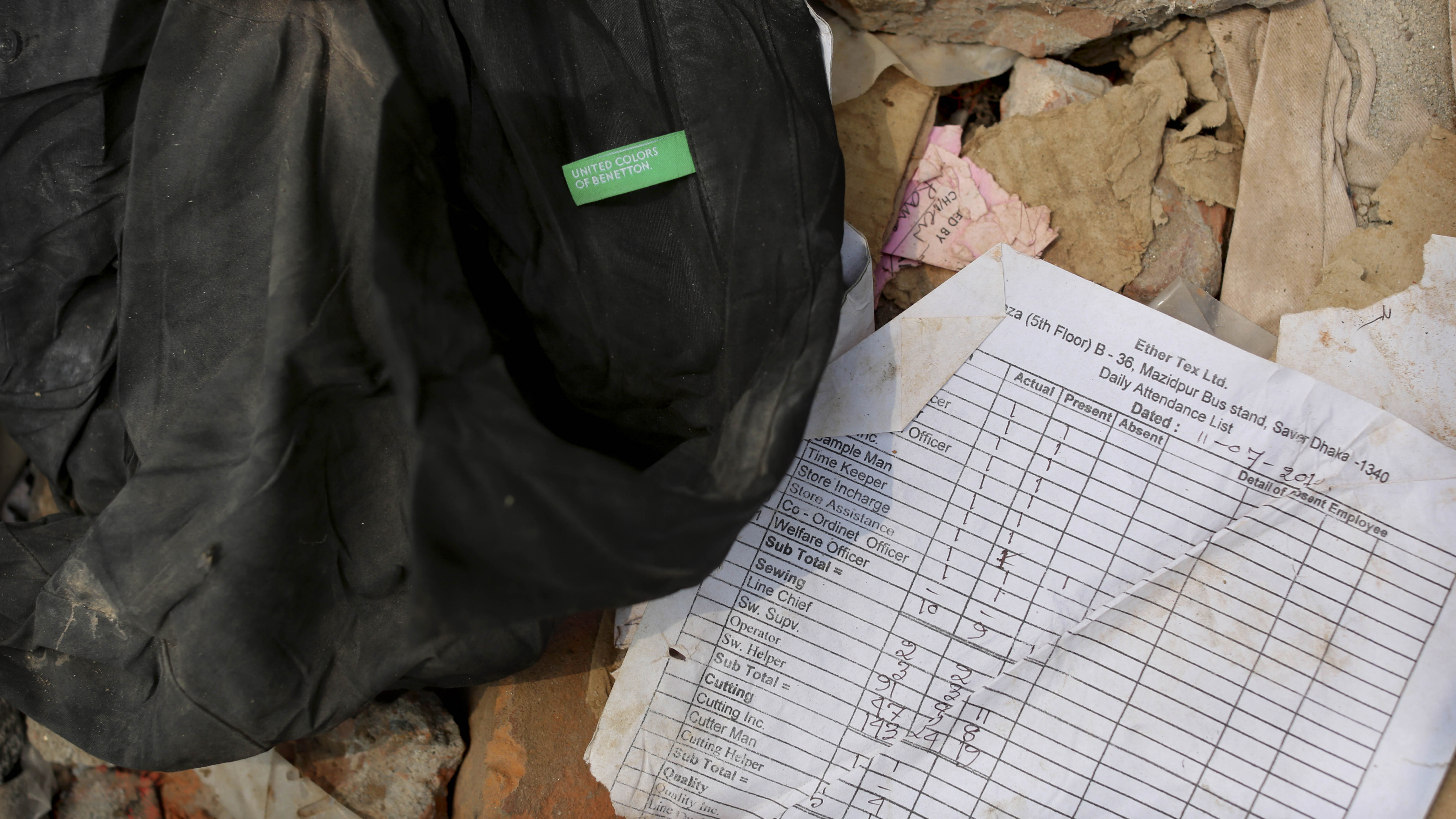 """A shirt labeled """"United Colors of Benneton"""" found in the rubble, along with an attendance sheet for workers."""