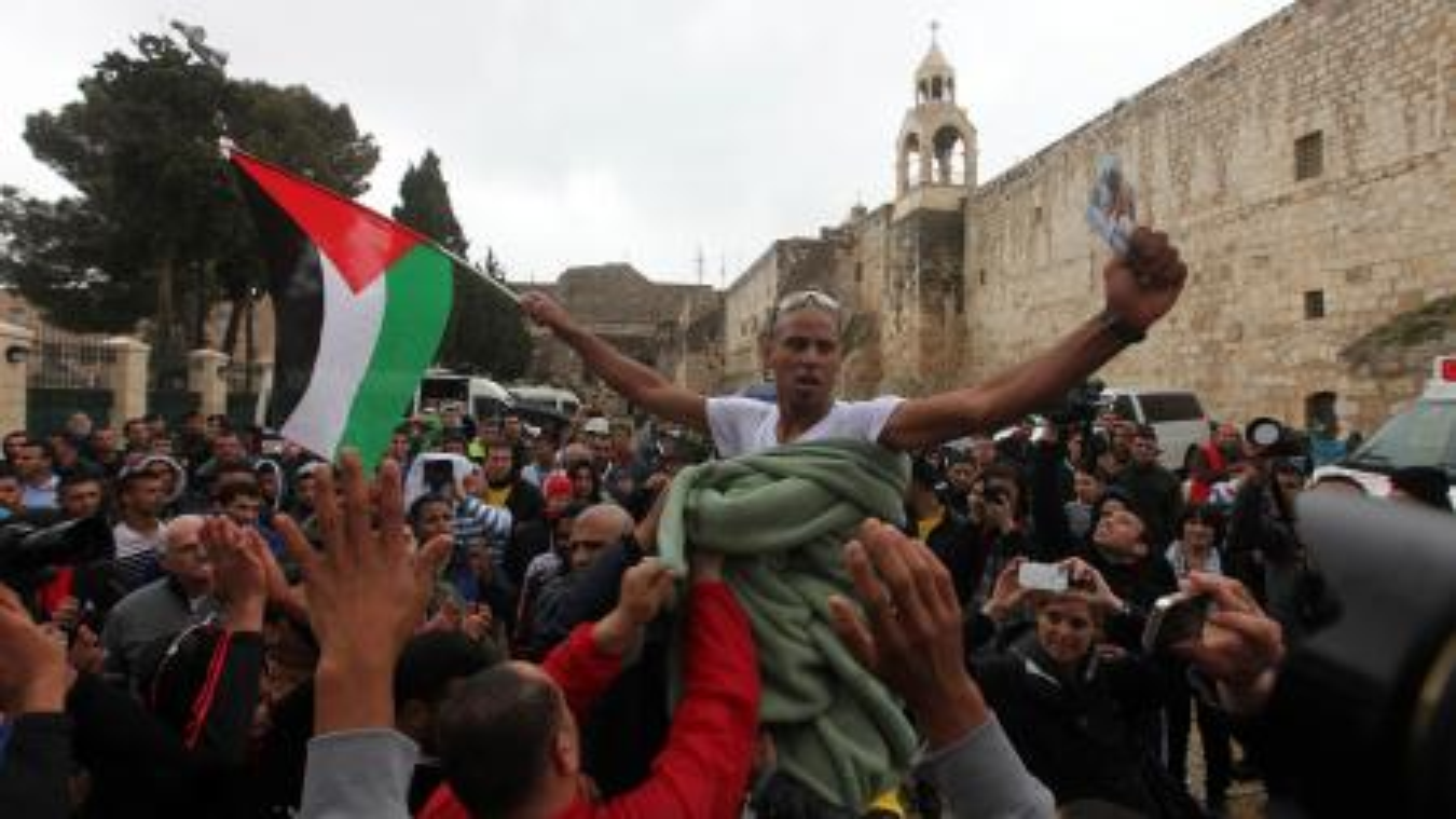 Abdel Nasser Awajme celebrating his win at the Bethlehem Marathon.