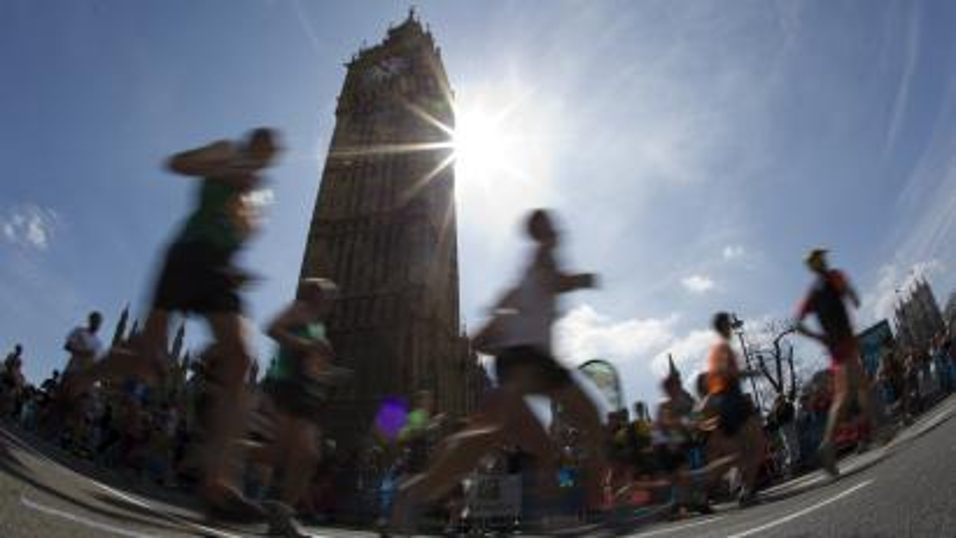 London Marathon runners going by Big Ben.