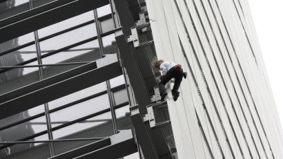 Alain Robert, known as the French Spiderman, scaling the Times Building in 2008.