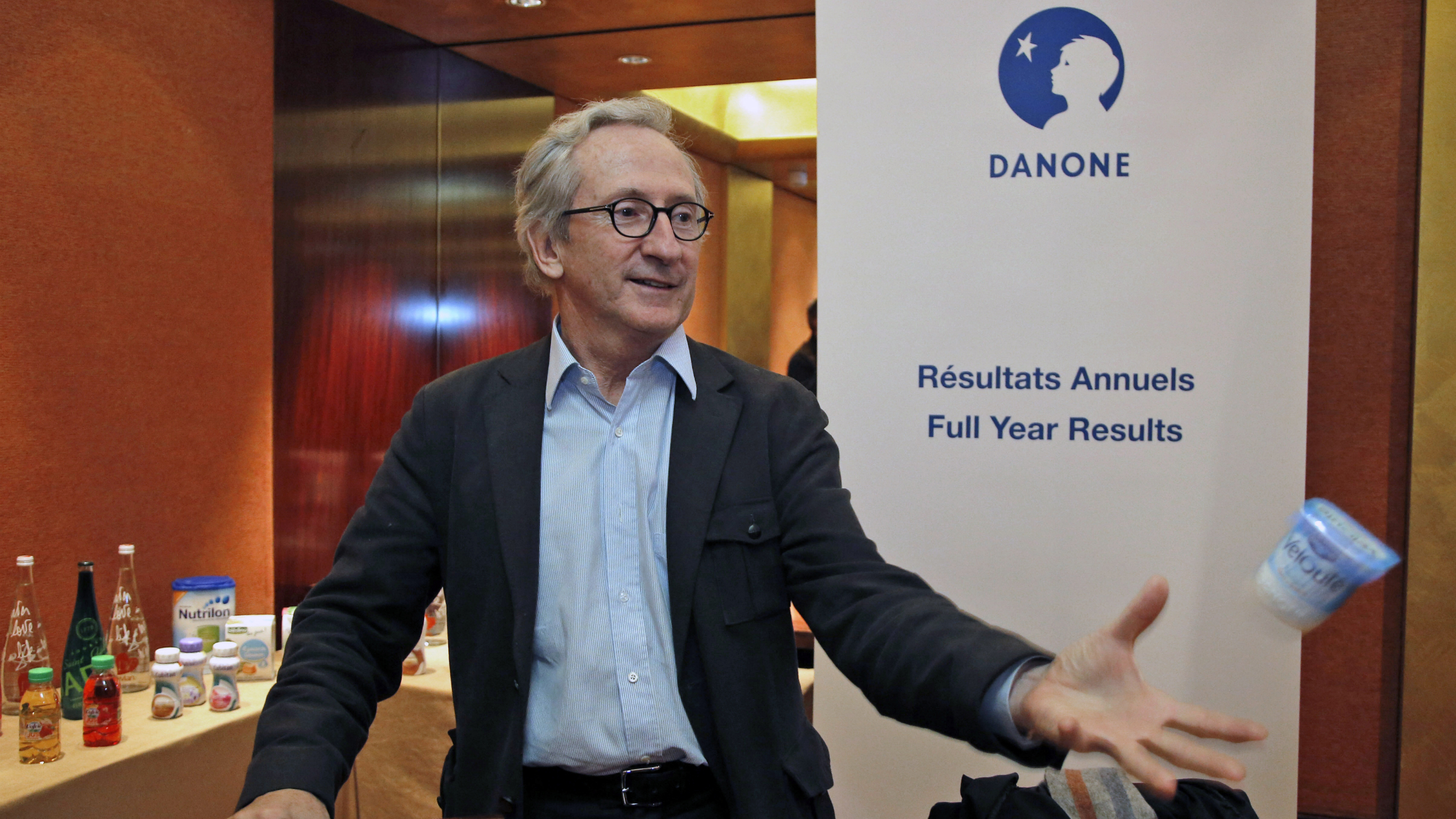 Danone chief executive Franck Riboud poses prior to delivering a speech for the 2012 year financial results conference in Paris, Tuesday, Feb. 19, 2013. French food and drink company Danone says revenues grew 5.4 percent in 2012 but are coming under increasing pressure in economically-struggling Europe, where the company says it will cut 900 jobs across 26 countries. (AP Photo/Francois Mori