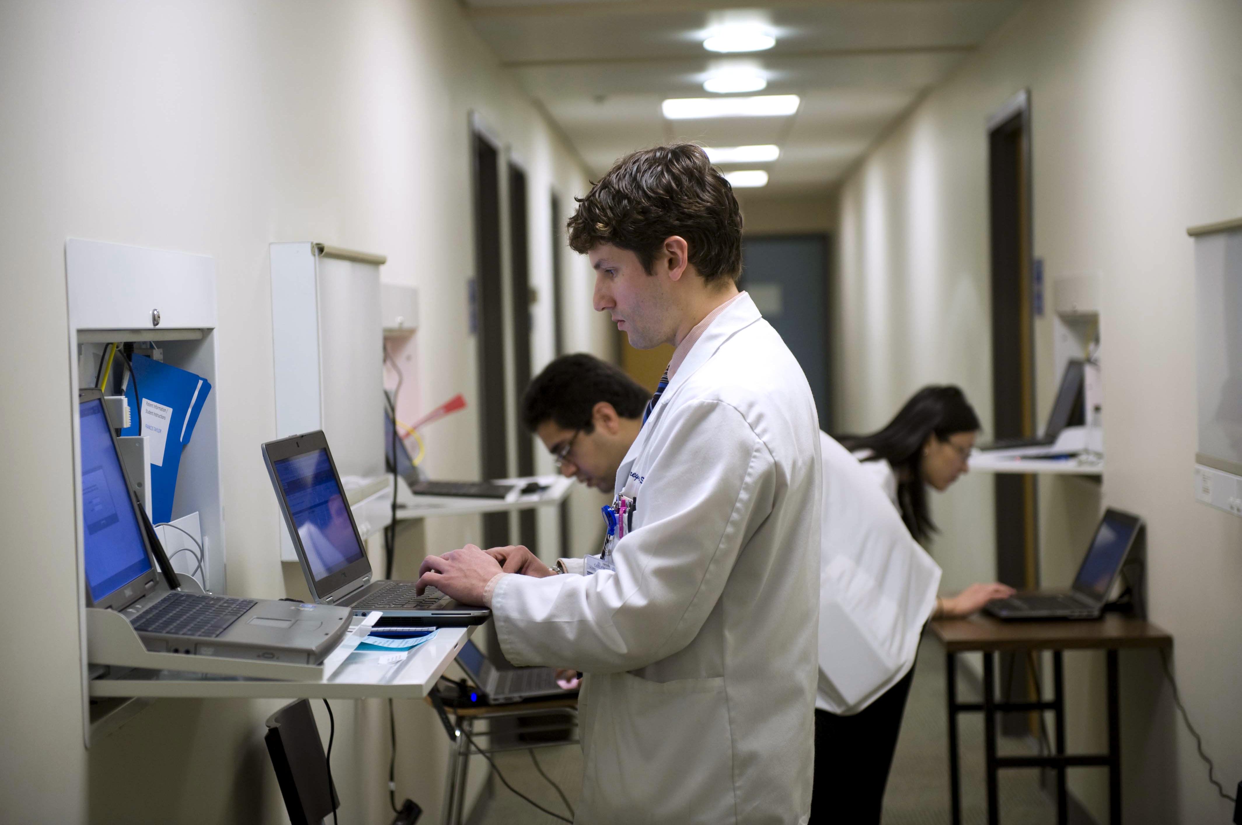 Doctors using computers