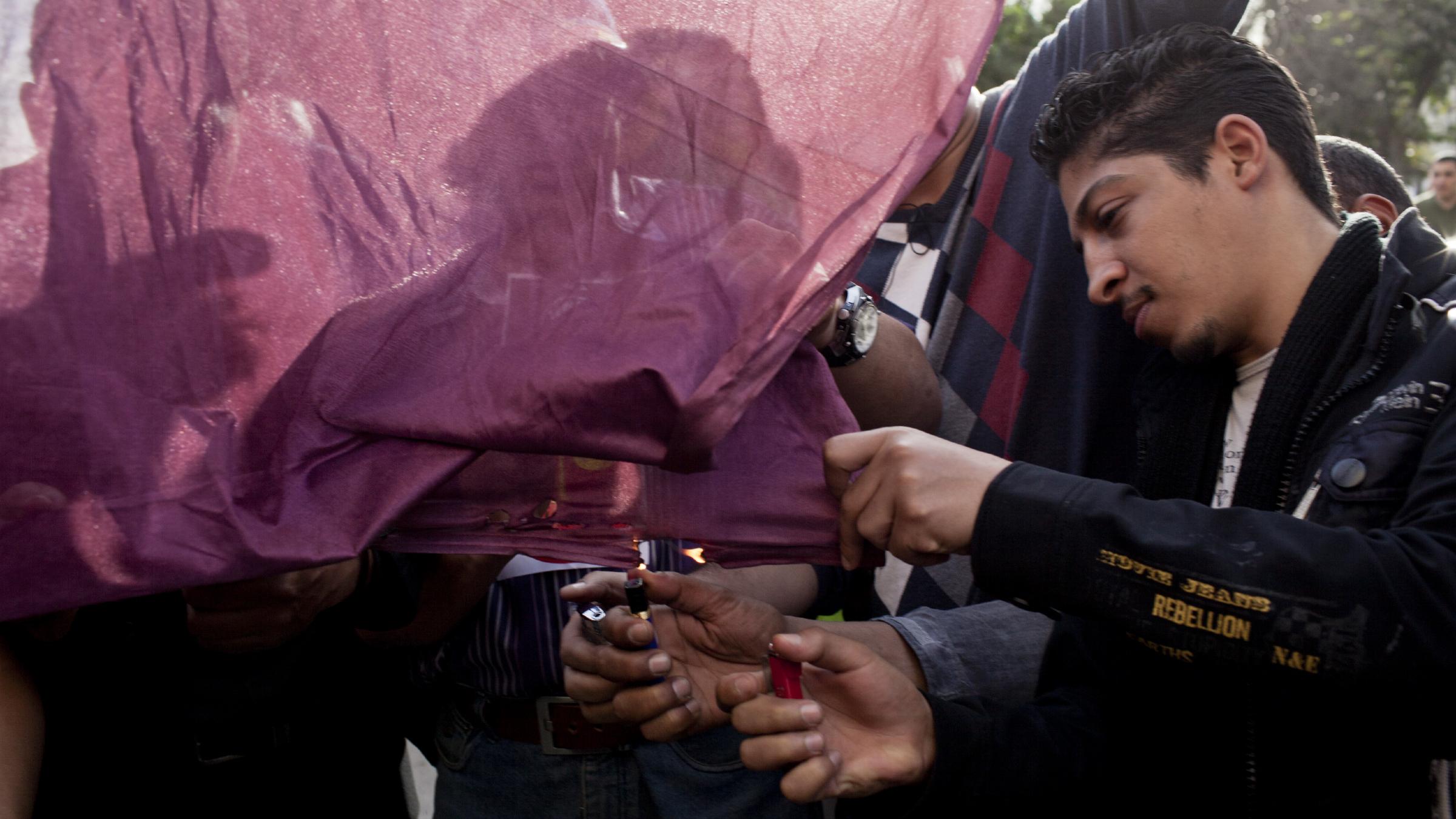 Egyptians burning Qatari flag in protest