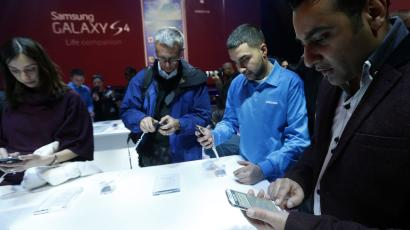 Attendees try out the new Samsung Galaxy S 4 during the Samsung Unpacked event at Radio City Music Hall, Thursday, March 14, 2013 in New York. (AP Photo/Jason DeCrow