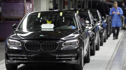 Employees control the new BMW luxury car's at the production line of the German car manufacturer's plant in Dingolfing near Munich, southern Germany, Wednesday, Dec. 19, 2012. (AP Photo/Matthias Schrader
