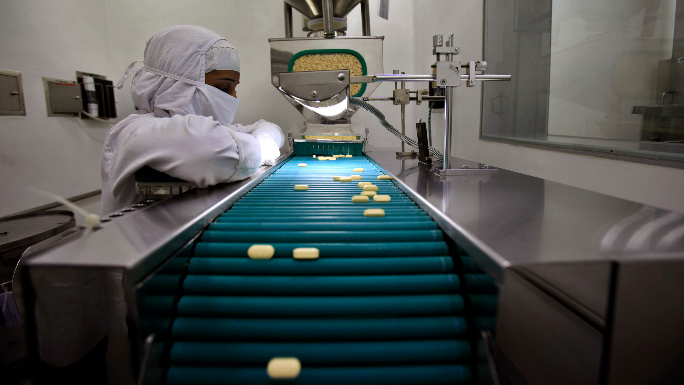 In this file photo taken Thursday, Feb. 9, 2012, a pharmacist is seen working in a lab where medicines are being produced at a manufacturing unit on the outskirts of Mumbai, India.