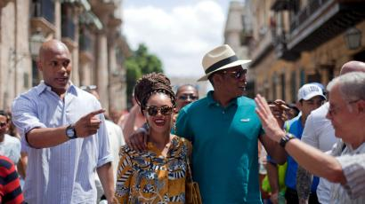 U.S. singer Beyonce and her husband, rapper Jay-Z, right, tours Old Havana as a body guard, left, and tour guide, right, accompany them in Cuba, Thursday, April 4, 2013. R&B's power couple is in Havana on their fifth wedding anniversary.