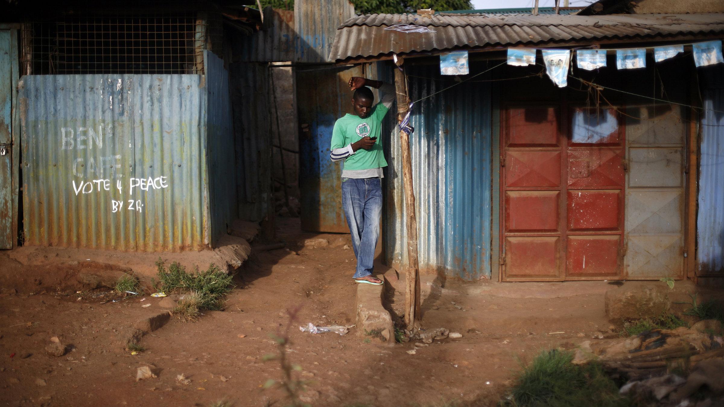 Kenyan man on mobile phone