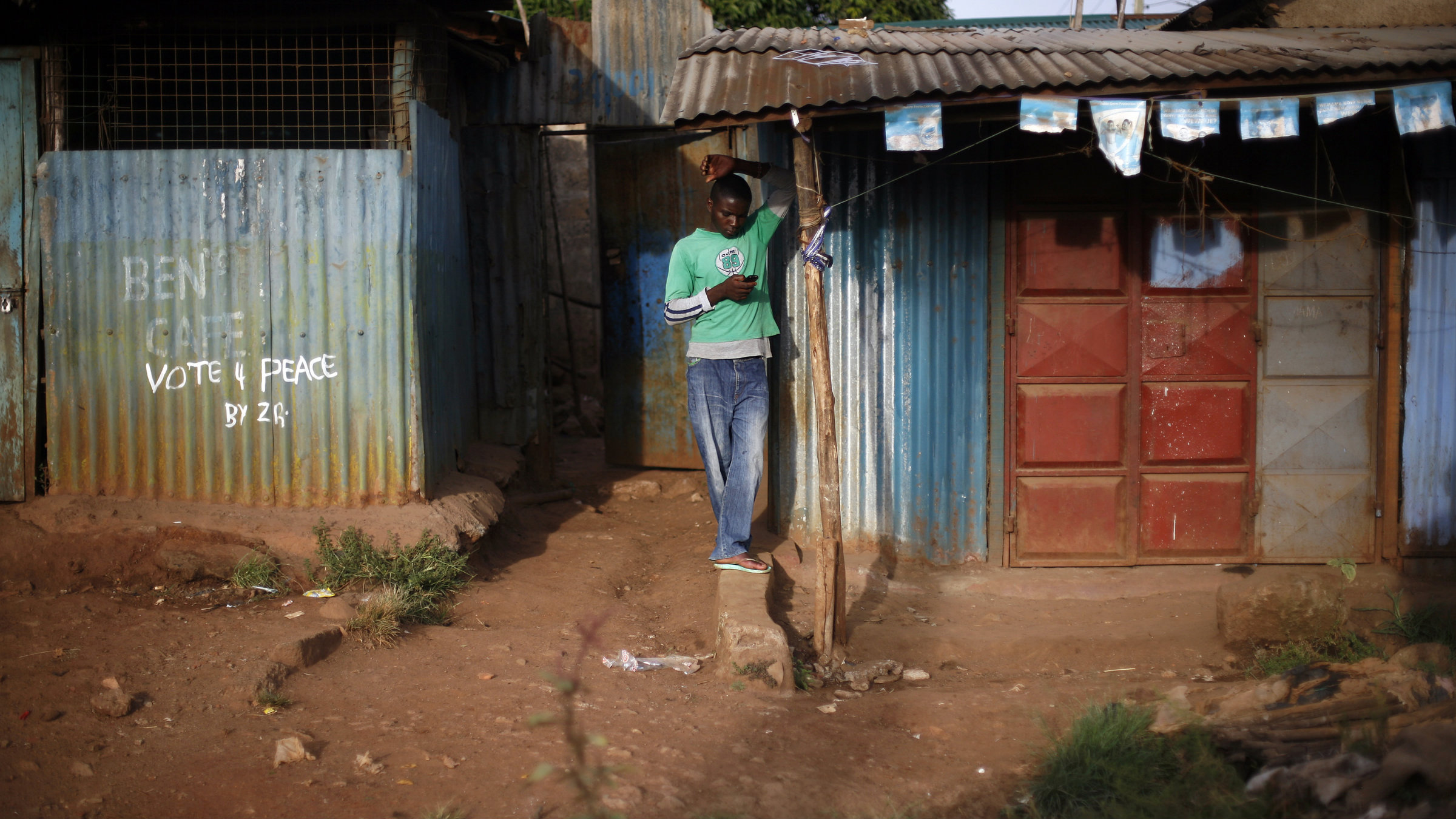 Kenyan man on mobile phone.