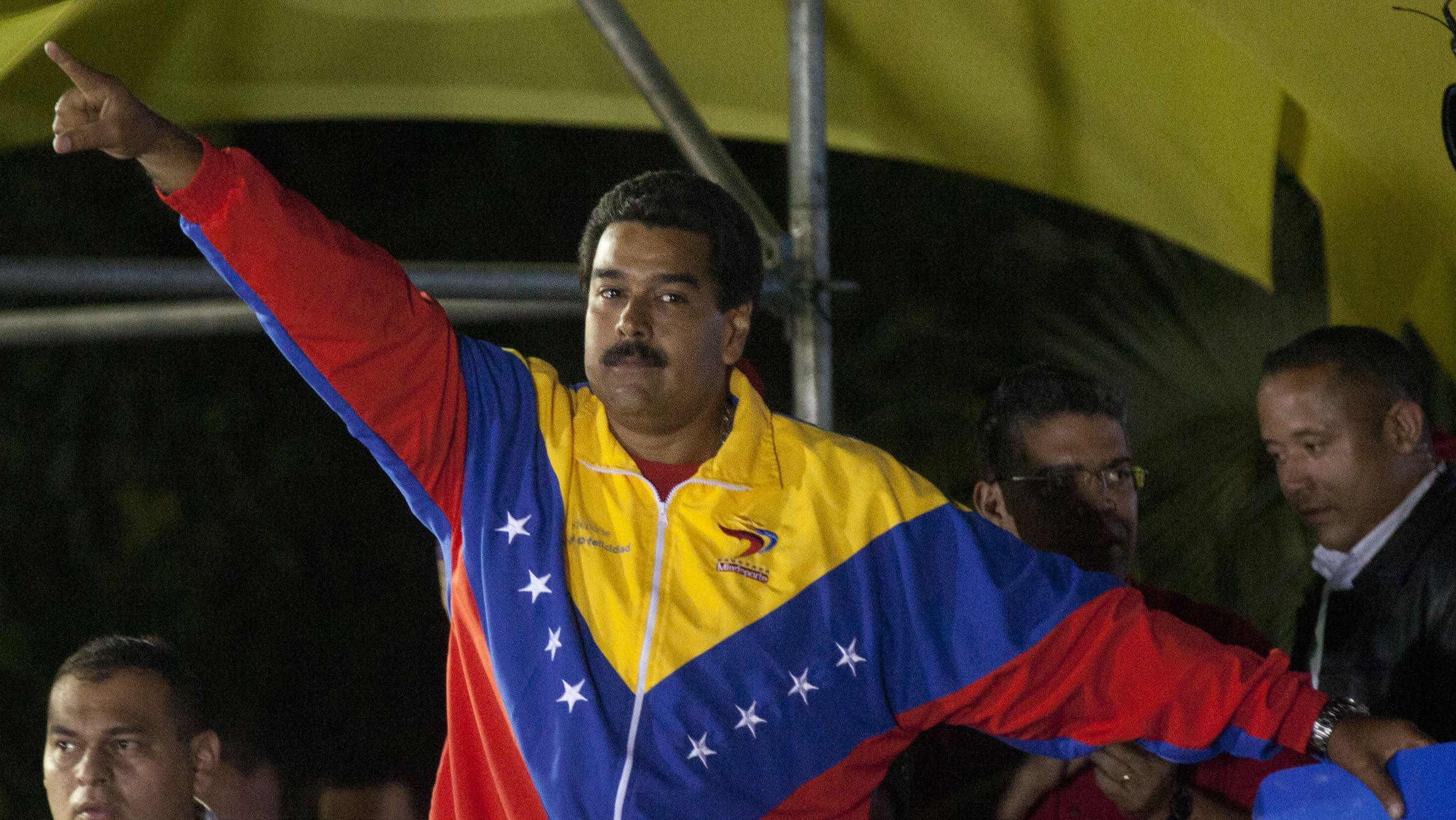 Venezuela's newly elected President Nicolas Maduro celebrates his victory after the official results of the presidential elections were announced, at the Miraflores Palace in Caracas, Venezuela, late Sunday, April 14, 2013. Maduro, Hugo Chavez's hand-picked successor, won a razor-thin victory in Sunday's special presidential election, edging the opposition leader Henrique Capriles by only about 300,000 votes, electoral officials announced. (AP Photo/Ramon Espinosa