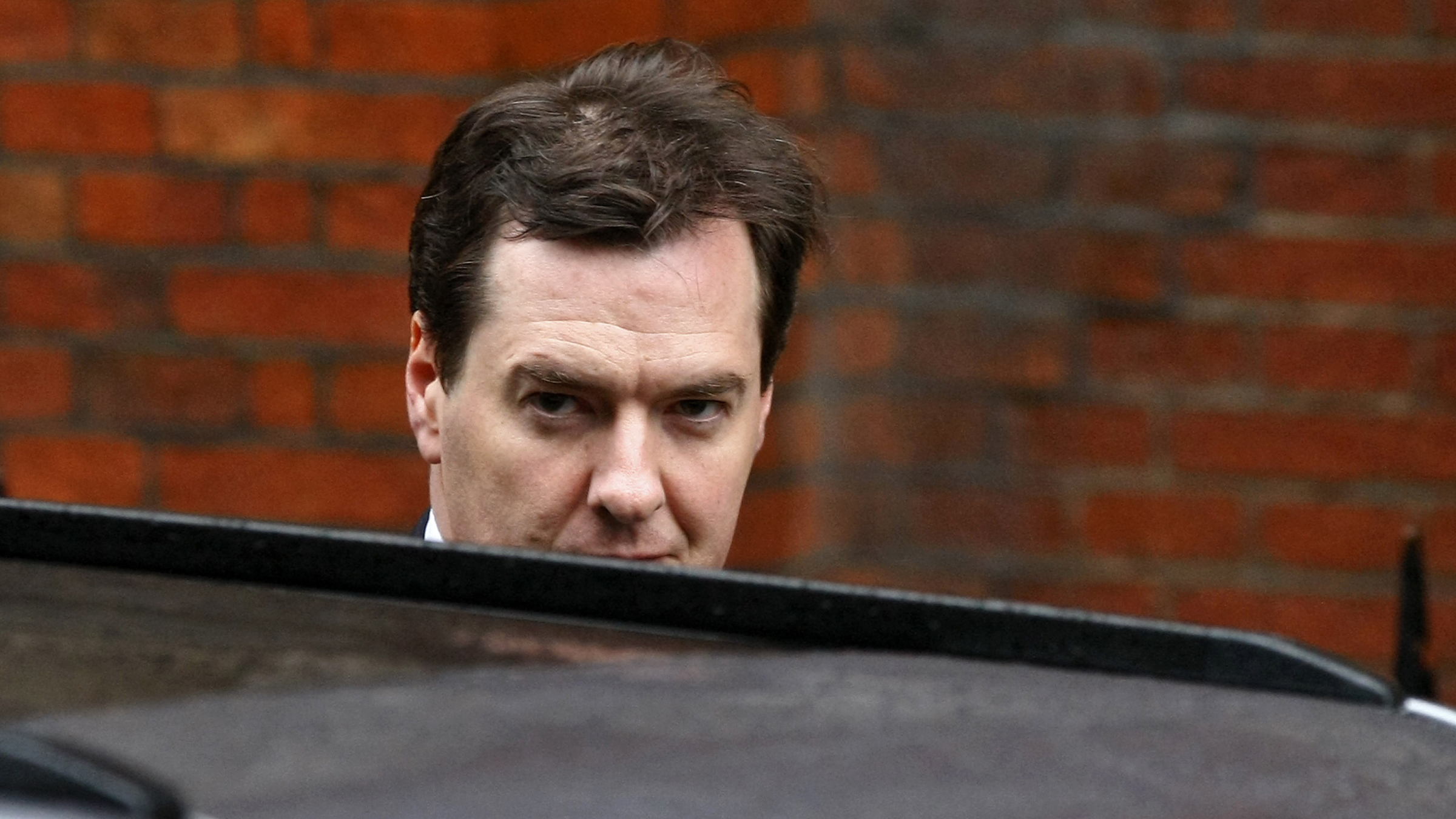 Britain's Chancellor of the Exchequer George Osborne arrives at the High Court to give evidence at the Leveson Inquiry, London, Monday, June 11, 2012. Former British Prime Minister Gordon Brown was the first in a string of current and former political leaders to appear this week at the inquiry, set up amid a tabloid phone hacking scandal to examine malpractice in the media and ties between politicians, police and the press. (AP Photo/Tim Hales
