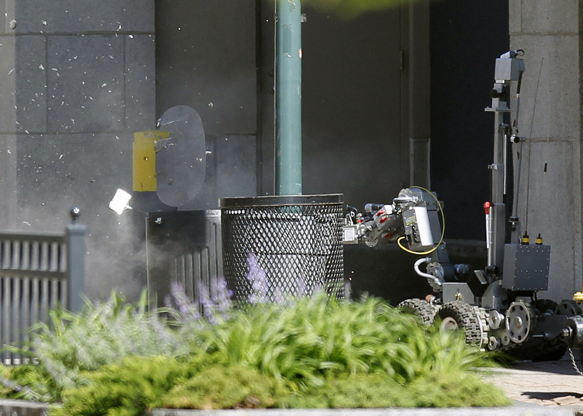 Police robot blowing up suspicious package