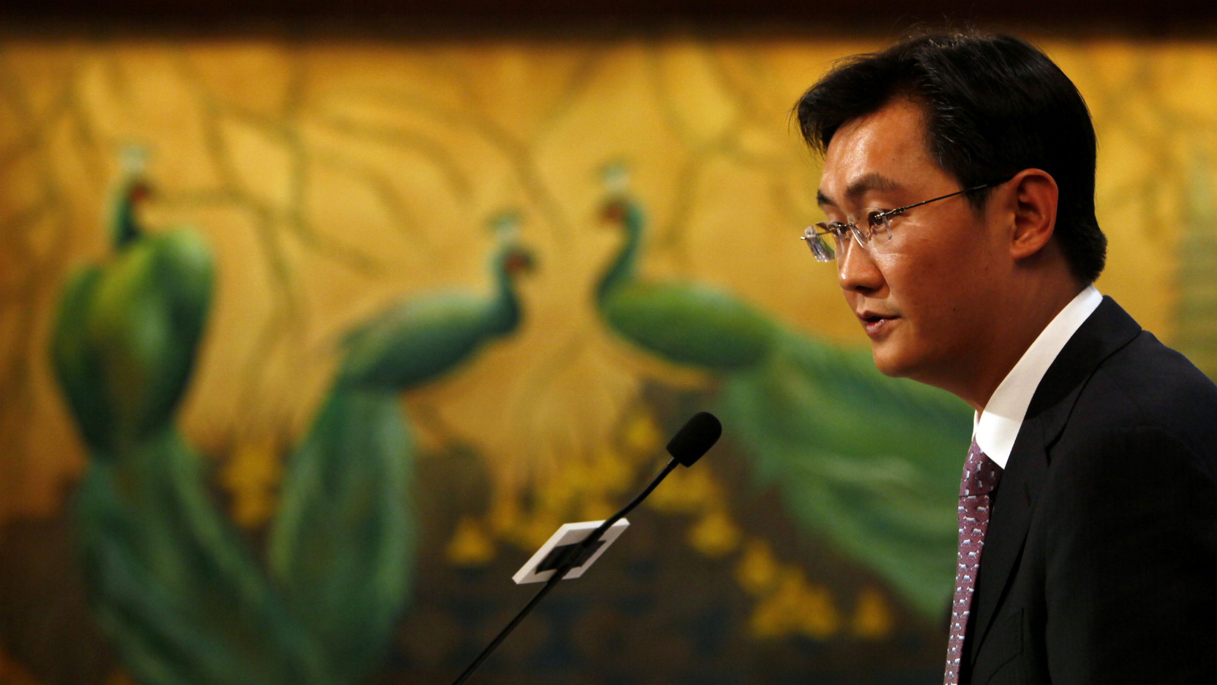 Pony Ma, chairman and CEO of Tencent Holdings Ltd., speaks during the news conference for the 2009 fourth quarter and annual company result announcement in Hong Kong Wednesday, March 17, 2010. Tencent, a leading provider of Internet and mobile and telecommunications services in China, announced their profit for the year was RMB5,221.6 million (US$764.7 million), an increase of 85.4% year on year. (AP Photo/Kin Cheung
