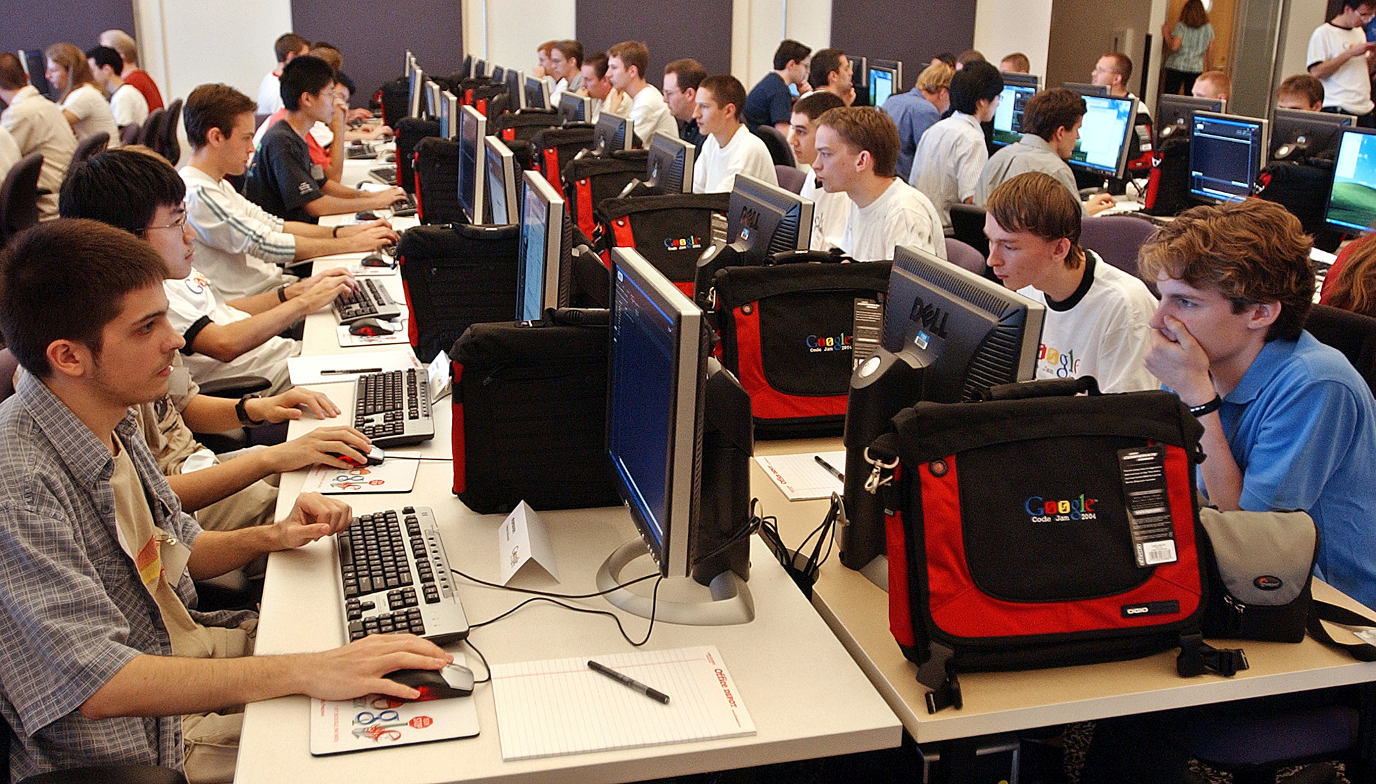 "Contestants compete in ""computer code jam,"" a competition among hard-core computer programmers where they vie for cash prizes and possible employment in the high tech industry Friday, Oct. 15, 2004, at Google Inc., in Mountain View, Calif."