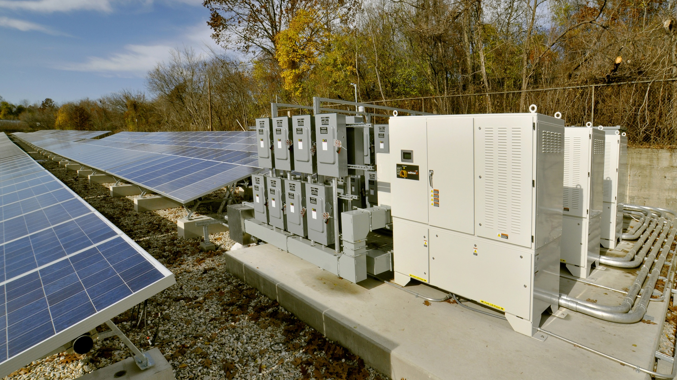 HOLD FOR STORY BY STEVEN SINGER MOVING WEEKEND OF NOV. 13-14 Inverters, pictured right, convert direct current (dc), which is gathered by solar panels, pictured left, into alternating current (ac), so that is can be used by consumers. The largest solar energy plant in New England is this 1.8 megawatt facility in Pittsfield, Massachusetts, run by the Western Massachusetts Electric Company Wednesday, November 10, 2010. (AP Photo/Stewart Cairns)