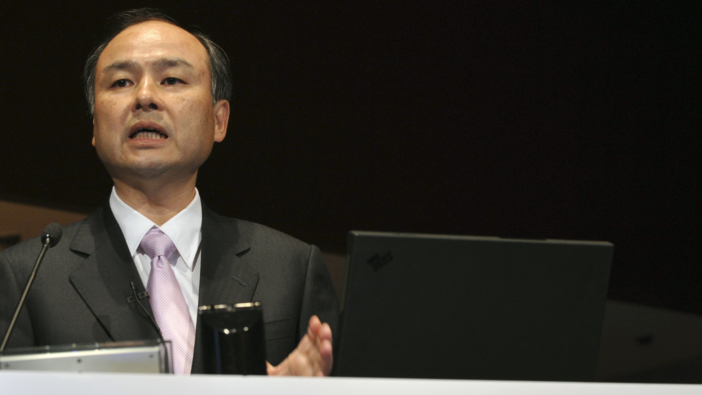 Japan's No. 3 mobile carrier Softbank Corp. Chief Executive Masayoshi Son speaks during a news conference in Tokyo Thursday, Feb. 5, 2009. Softbank said Thursday that its core business grew in the third quarter but that net profit fell 63 percent without the benefit of one-time gains last year from a new listing of a Hong Kong affiliate. Softbank posted a net profit of 17.1 billion yen ($191.1 million) for the October-December quarter, compared with 46.7 billion yen during the same period a year earlier. (AP Photo/Katsumi Kasahara