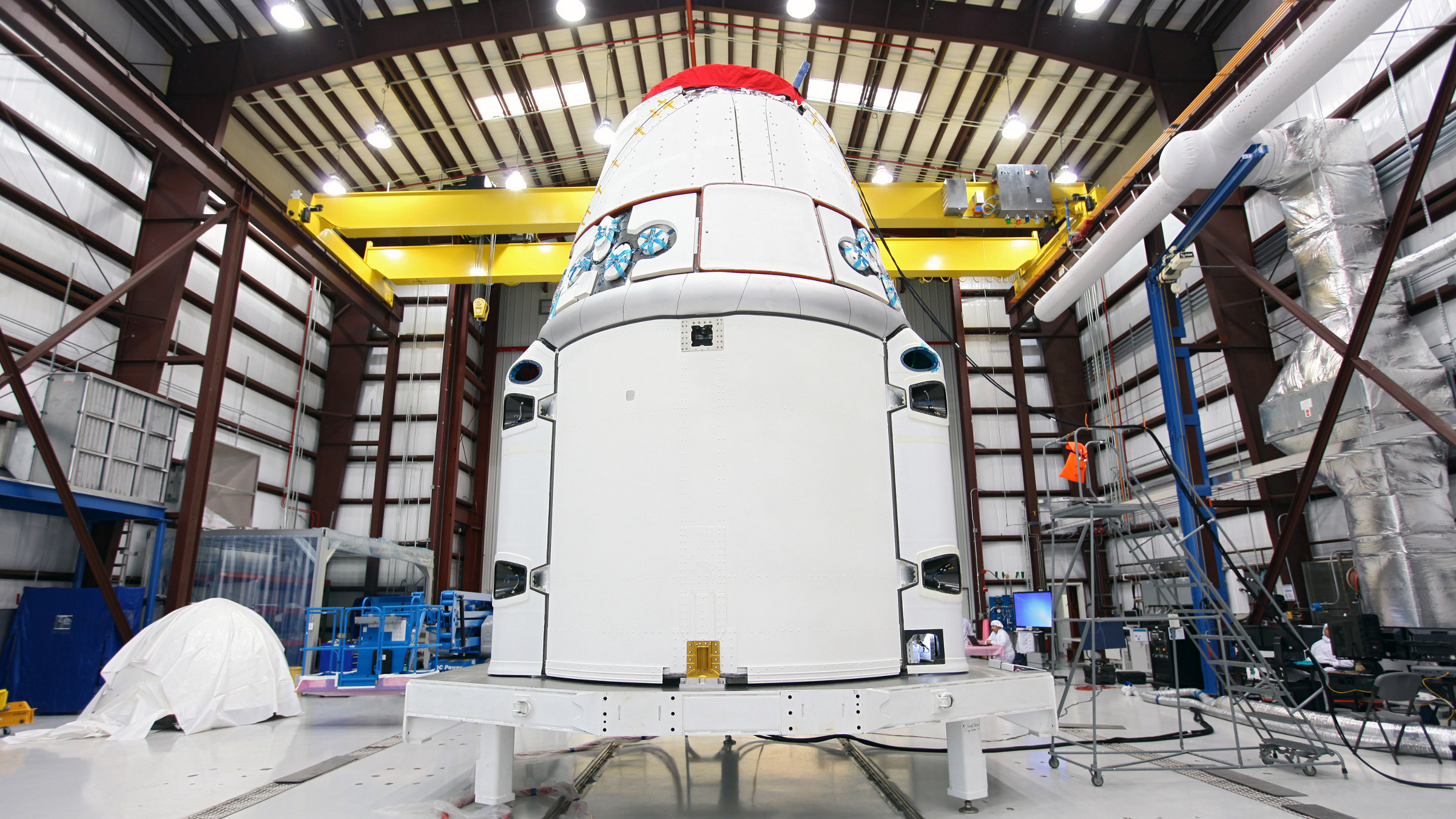 This Jan. 12, 2013 photo provided by NASA shows the Dragon spacecraft inside a processing hangar at Cape Canaveral Air Force Station in Cape Canaveral, Fla. where teams had just installed the spacecraft's solar array fairings. The California company known as SpaceX is scheduled to launch its unmanned Falcon rocket on Friday morning, March 1, 2013, carrying a Dragon capsule containing more than a ton of food, tools, computer hardware and science experiments.